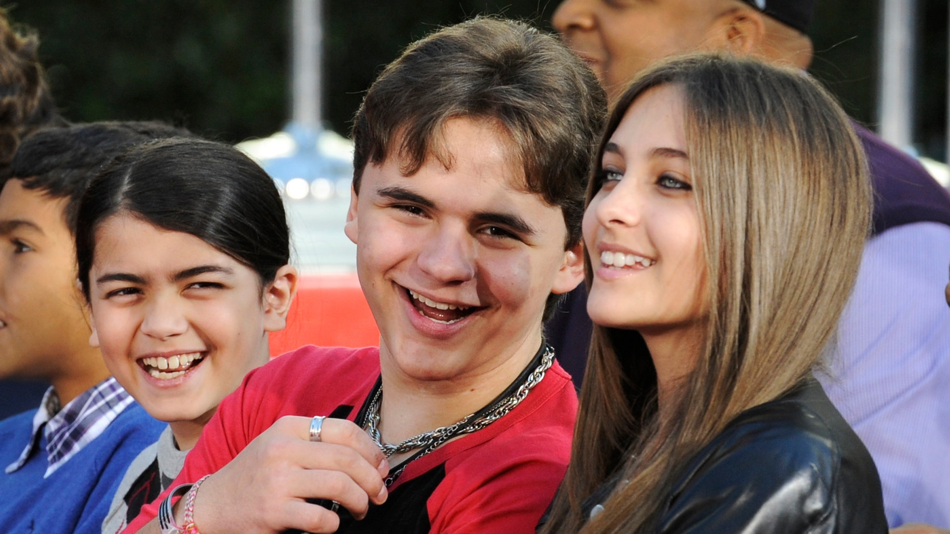 Paris and Prince with their younger brother Blanket.