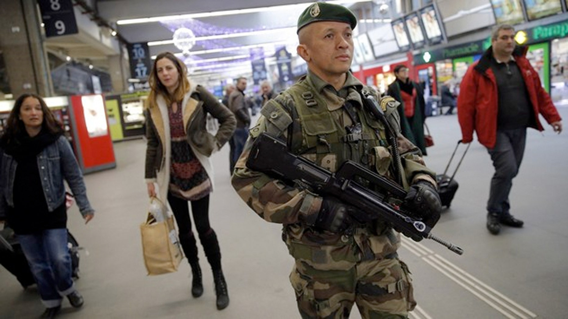 As of late Friday evening, Charles de Gaulle Airport remains open and trains are running, although security remains high.