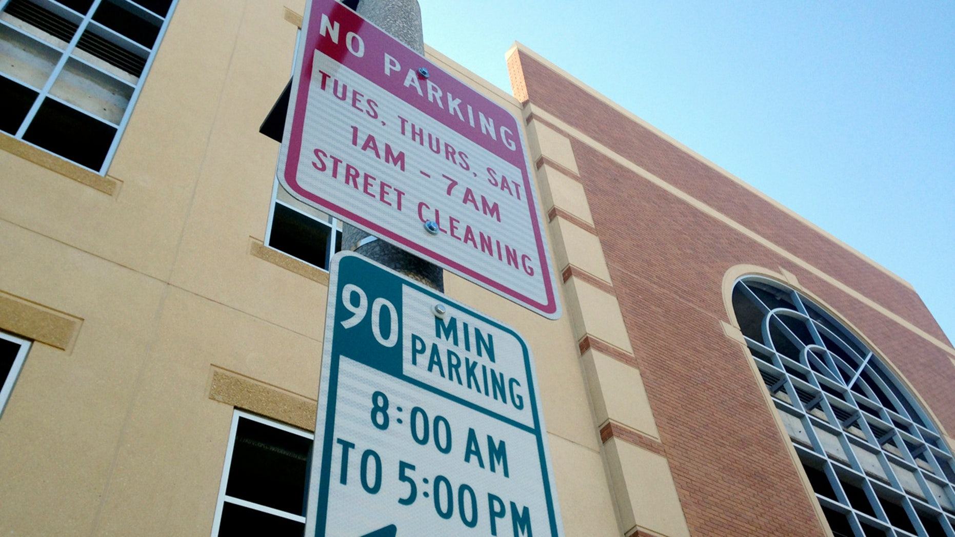 No Parking signs are displayed in downtown Bismarck, N.D., Tuesday, March 7, 2017. North Dakota is the only state that bans parking meters, but now Gov. Doug Burgum is quietly trying to end the nearly 70-year ban in hopes of revitalizing downtowns.