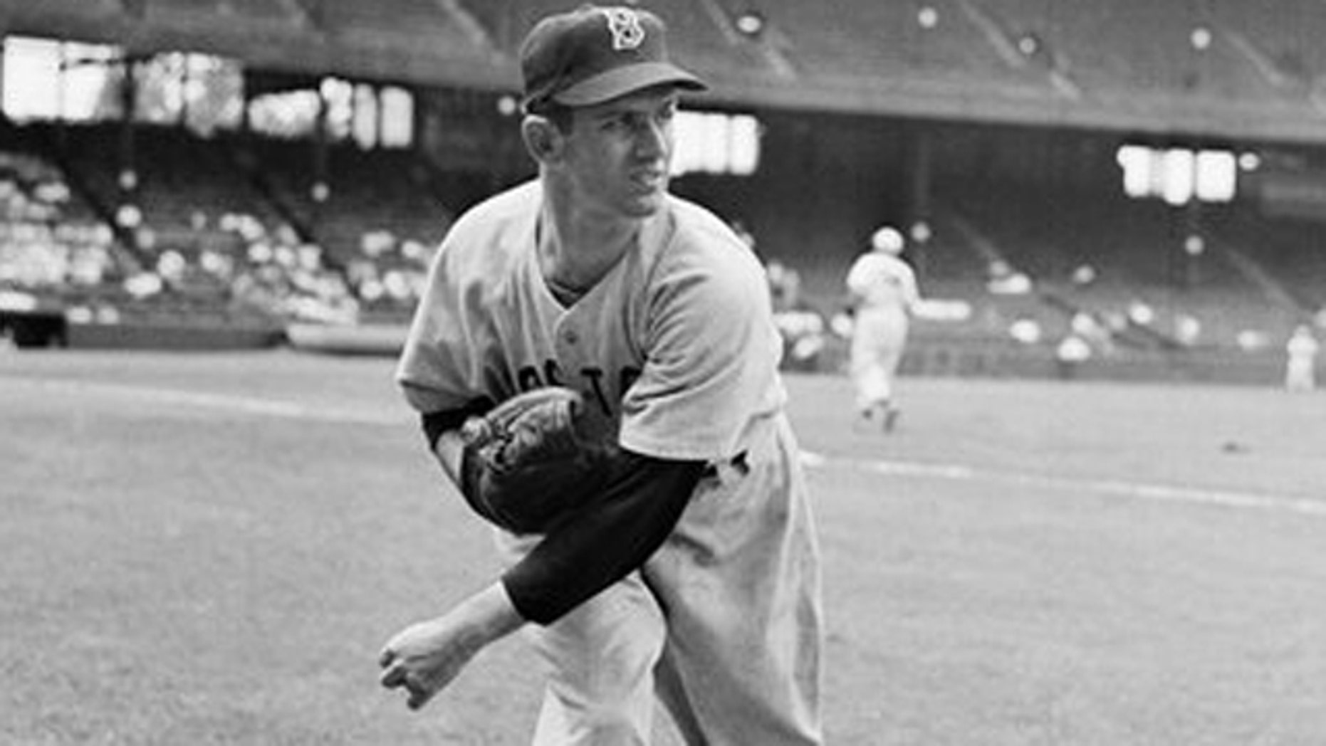 June 9, 1949: In this file photo, Boston Red Sox pitcher Mel Parnell warms up before a game in St. Louis. Parnell, the left-handed pitcher who faced the infamous Green Monster at Fenway Park and some of the best hitters of the 1940s and early 1950s, has died at age 89.