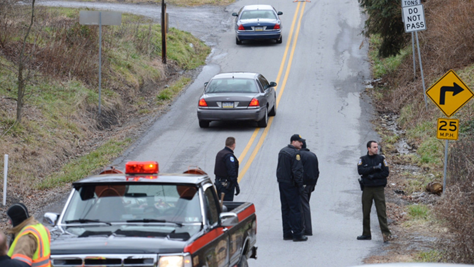 Dec. 21, 2012: Local law enforcement block off road along Rt. 22 near the Canoe Creek State Park, Pa. while investigating a shooting.