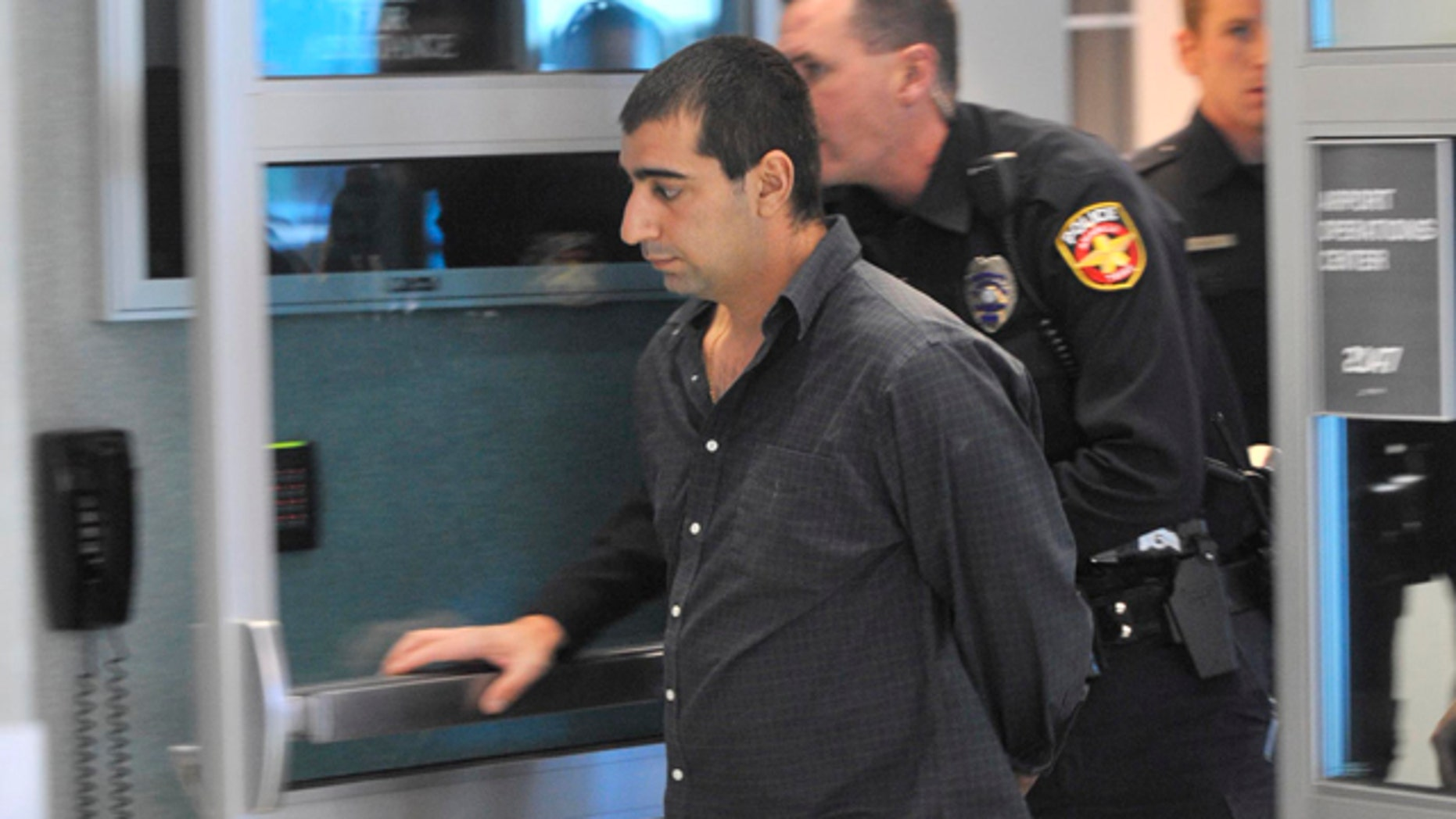 Oct. 28, 2011: Ali Reza Shahsavari, 29, of Indialantic, Fla., is escorted by Amarillo Police and FBI officers after causing a disturbance on a Southwest Airlines flight from Los Angeles to Kansas City.
