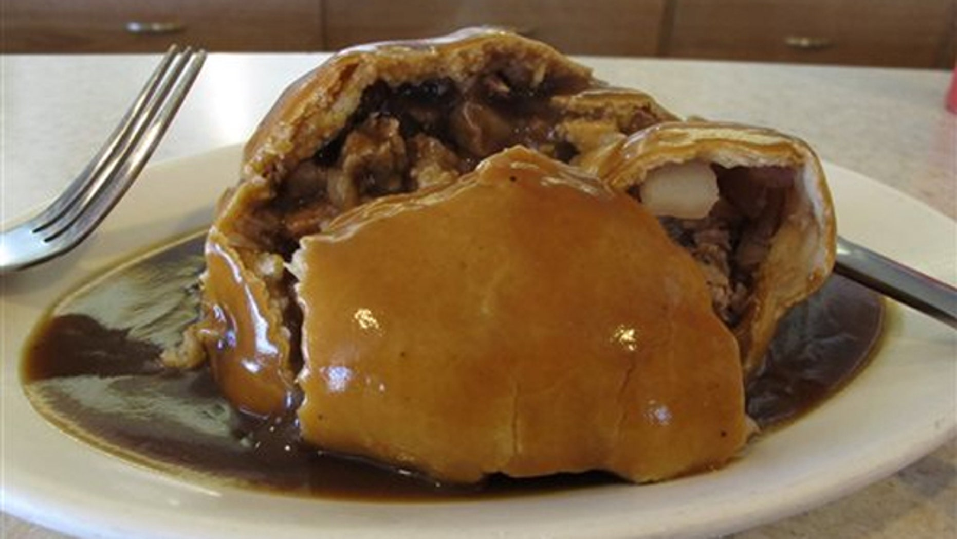 July 20, 2013:A meat-filled pasty with gravy from Joe's Pasty Shop in Butte, Mont.