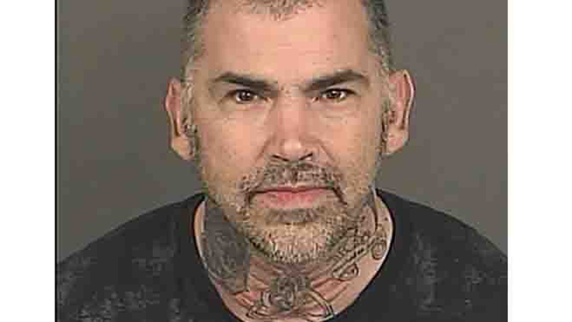 Jan. 29, 2014: In this file photo provided by the Denver District Attorney's Office suspect Michael Todd Abromovich is pictured.
