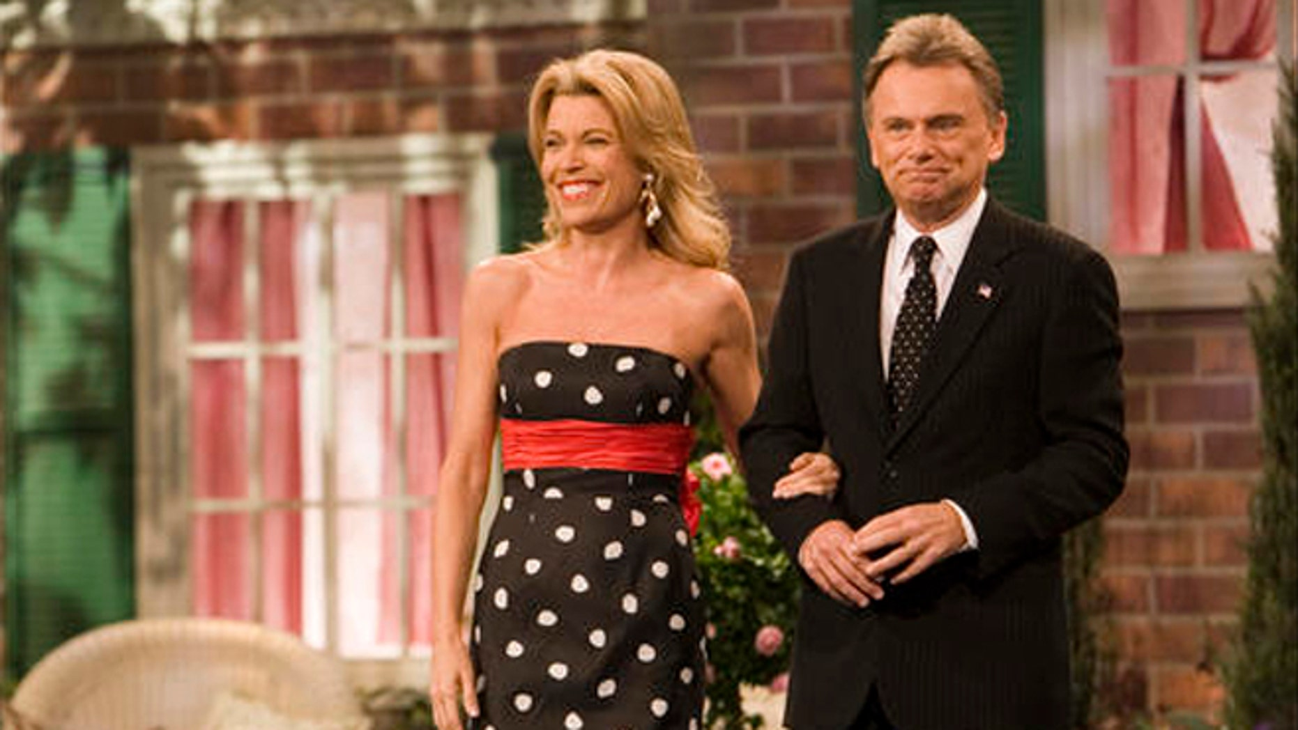 "Vanna White, a South Carolina native, and Pat Sajak, co-hosts of  the television show ""Wheel of Fortune"" greet the crowd on the set in North Charleston, S.C., Saturday, Jan. 12, 2007."