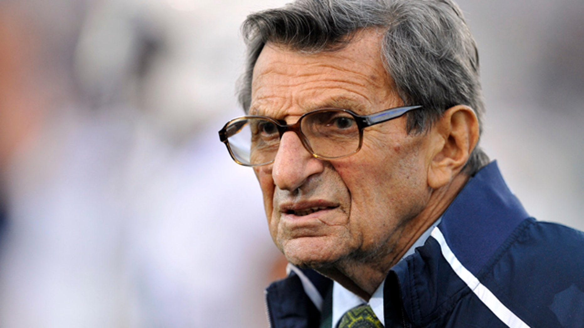FILE - In this Oct. 22, 2011 file photo, Penn State coach Joe Paterno stands on the field before his team's NCAA college football game against Northwestern, in Evanston, Ill.