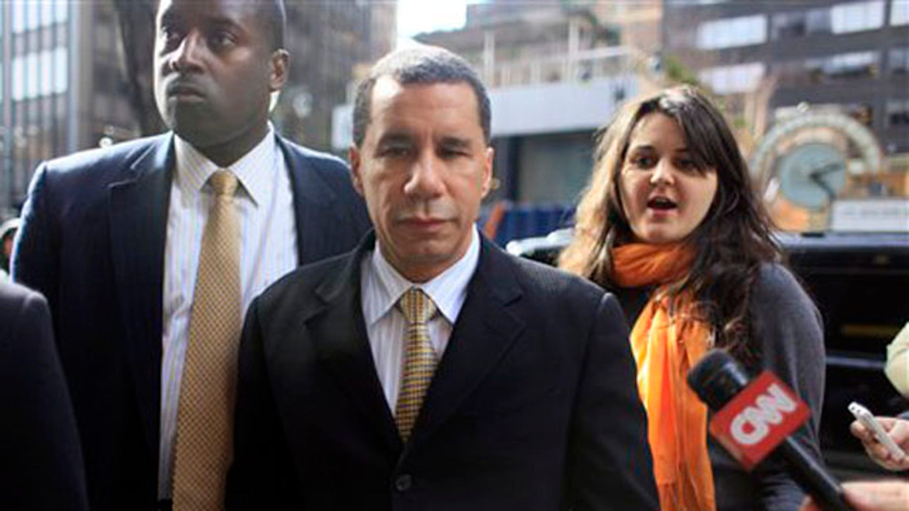 March 5, 2010: New York Gov. David Paterson, center, arrives at his midtown office (AP).
