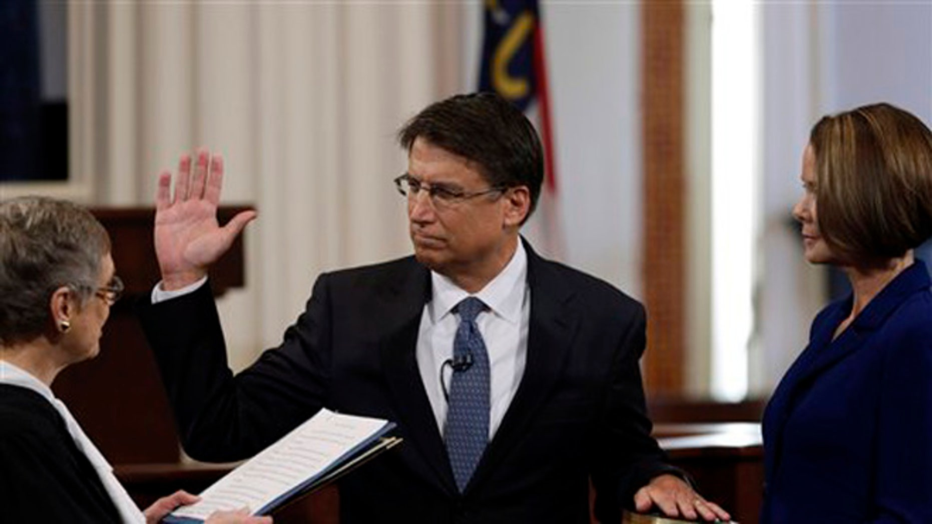 FILE: Jan. 5, 2013: Then-Gov.-elect Pat McCrory is sworn in as North Carolina governor in the House chamber of the old Capitol building in Raleigh, N.C.