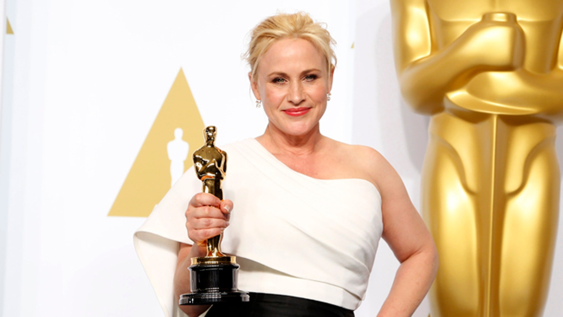 "Feb 22, 2015. Patricia Arquette, best supporting actress winner for her role in ""Boyhood"" poses with her award during the 87th Academy Awards."