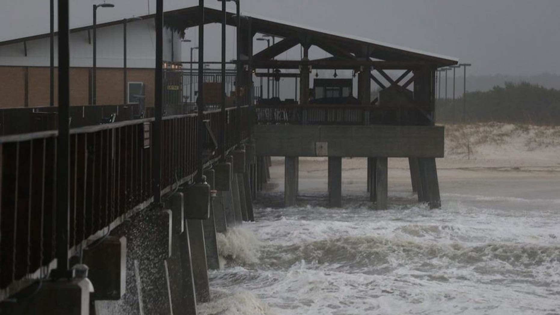 The remnants of Hurricane Patricia striking Gulf Shores, Alabama Monday. (Brian Kelly/Mobile Press-Register via AP)