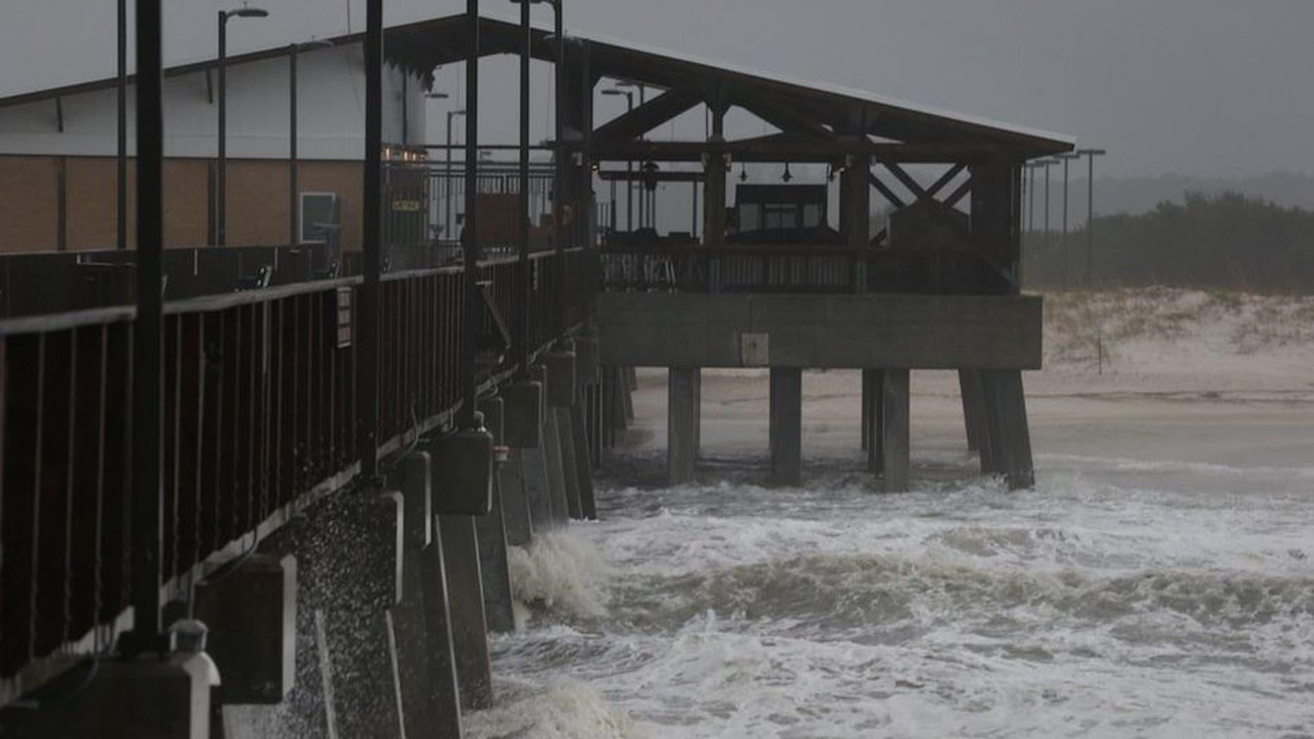 The remnants of Hurricane Patricia striking Gulf Shores, Alabama Monday. (Brian Kelly/Mobile Press-Register via AP)