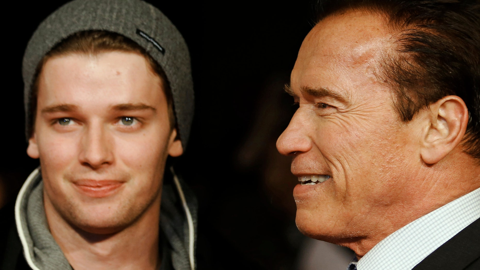 """January 22, 2013. Actor and former California governor Arnold Schwarzenegger (R) poses with his son Patrick as they arrive for the British premiere of """"The Last Stand"""" at Leicester Square in London."""