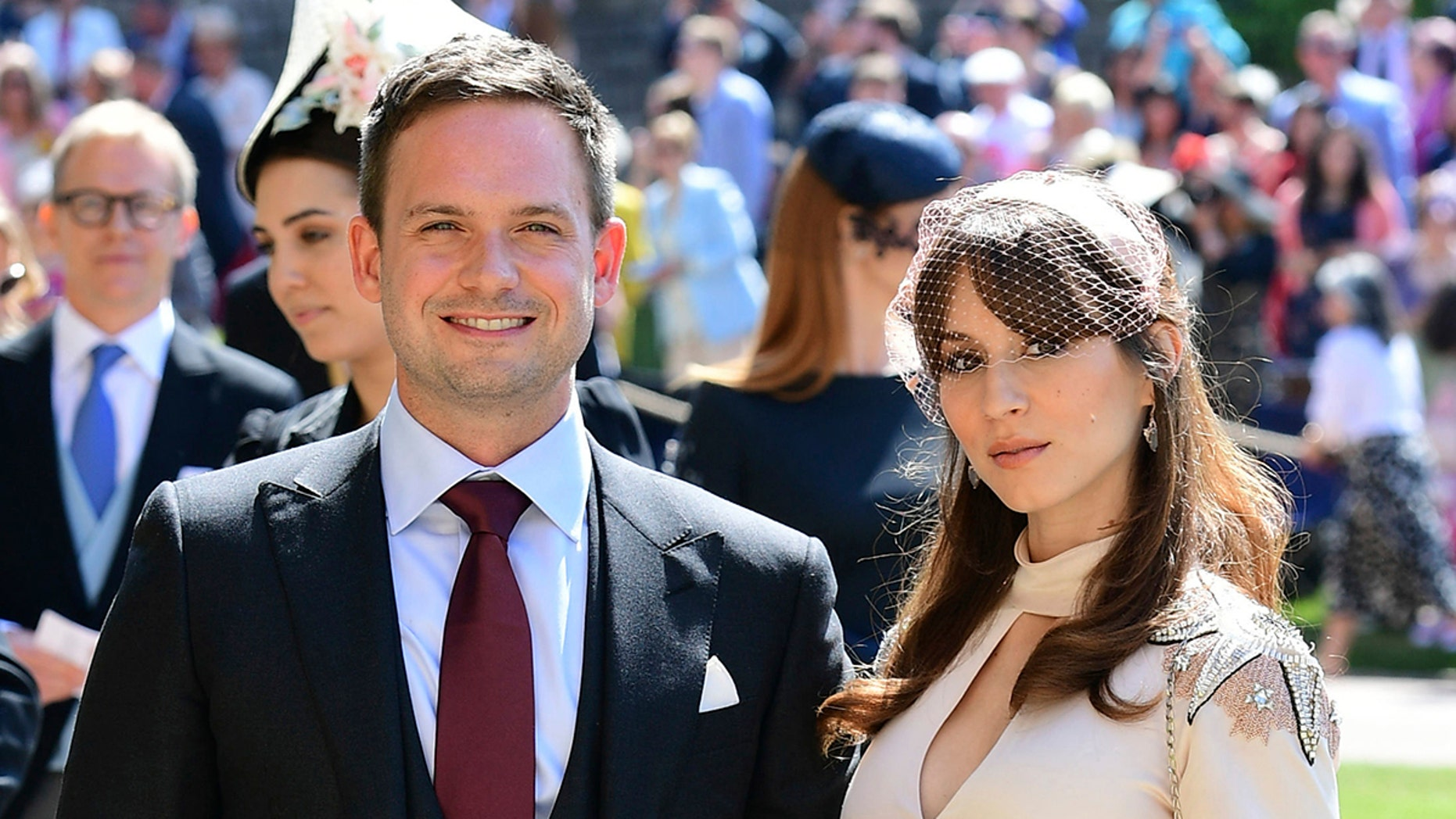 Patrick J. Adams and wife Troian Bellisario arrive a for the wedding ceremony of Prince Harry and Meghan Markle at St. George's Chapel in Windsor Castle in Windsor, near London, England, Saturday, May 19, 2018. (Ian West/pool photo via AP)