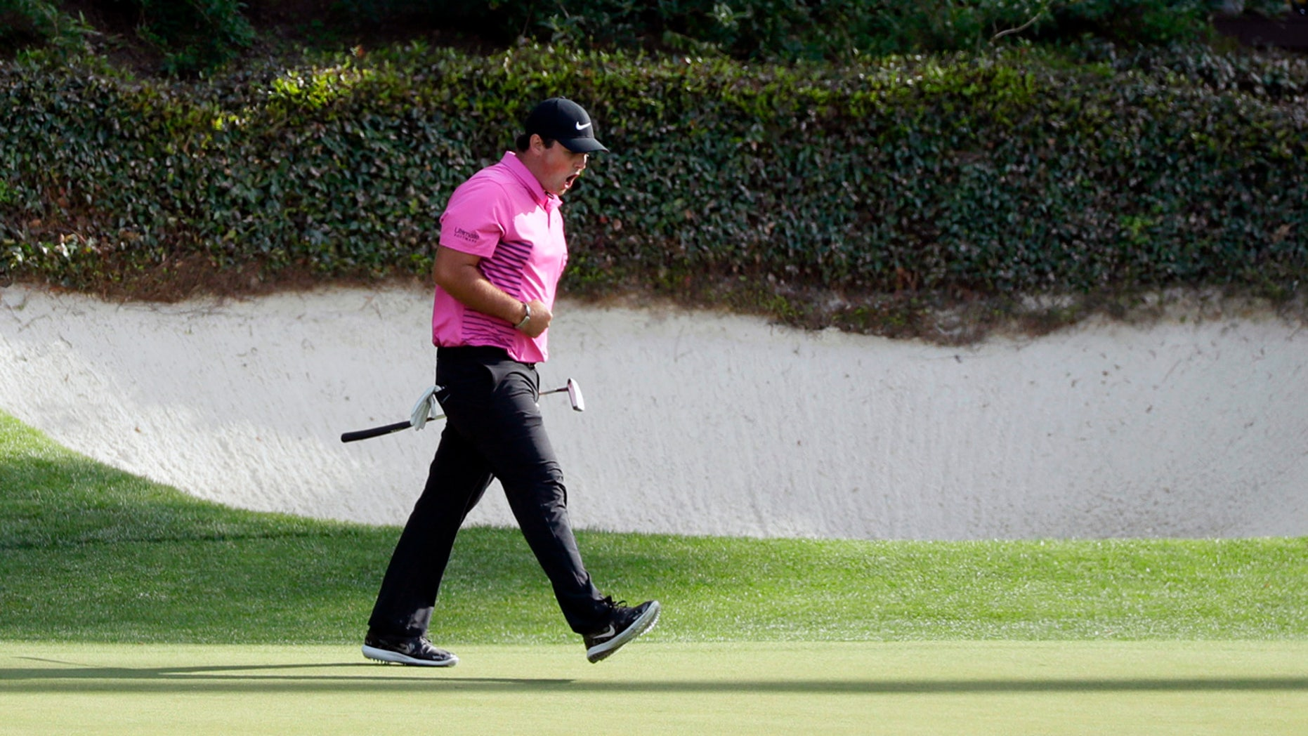 Patrick Reed reacts after making birdie at the 12th hole at the Masters Sunday.