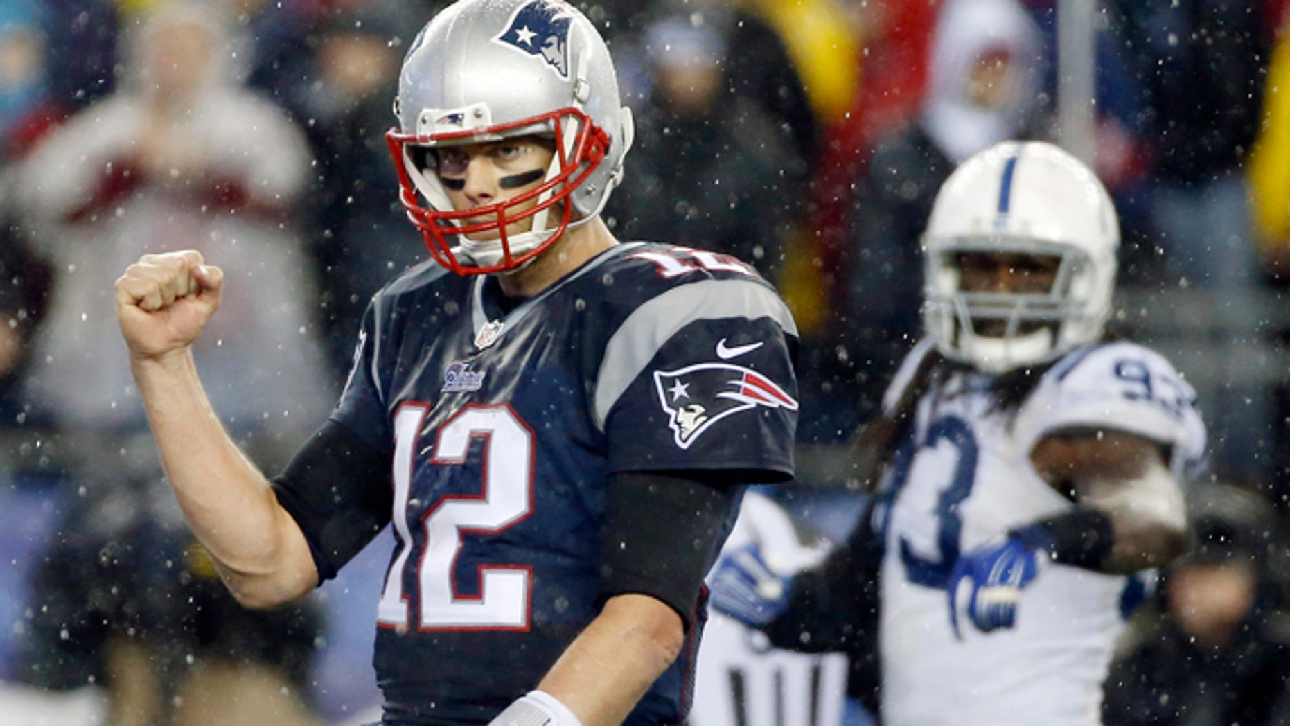 Jan. 18, 2015: New England Patriots quarterback Tom Brady (12) celebrates LeGarrette Blount's touchdown during the second half of the NFL football AFC Championship game against the Indianapolis Colts.
