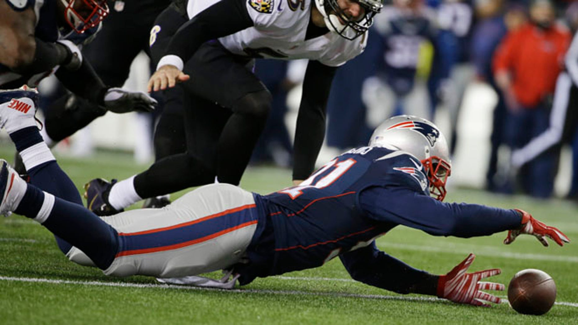 Jan. 10, 2015: New England Patriots outside linebacker Jamie Collins (91) recovers a fumble by Baltimore Ravens quarterback Joe Flacco (5) after a sack in the second half of an NFL divisional playoff football game in Foxborough, Mass. (AP)