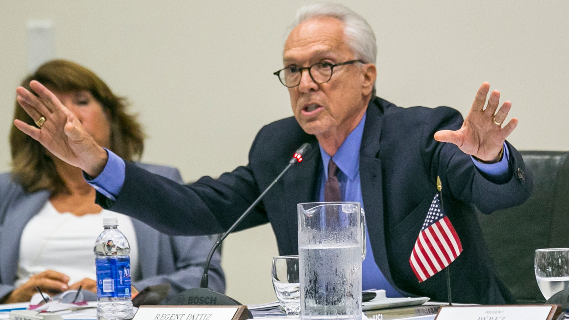 University of California Regent Norman Pattiz, right, addresses fellow board members in Irvine, Calif., Sept. 17, 2015.