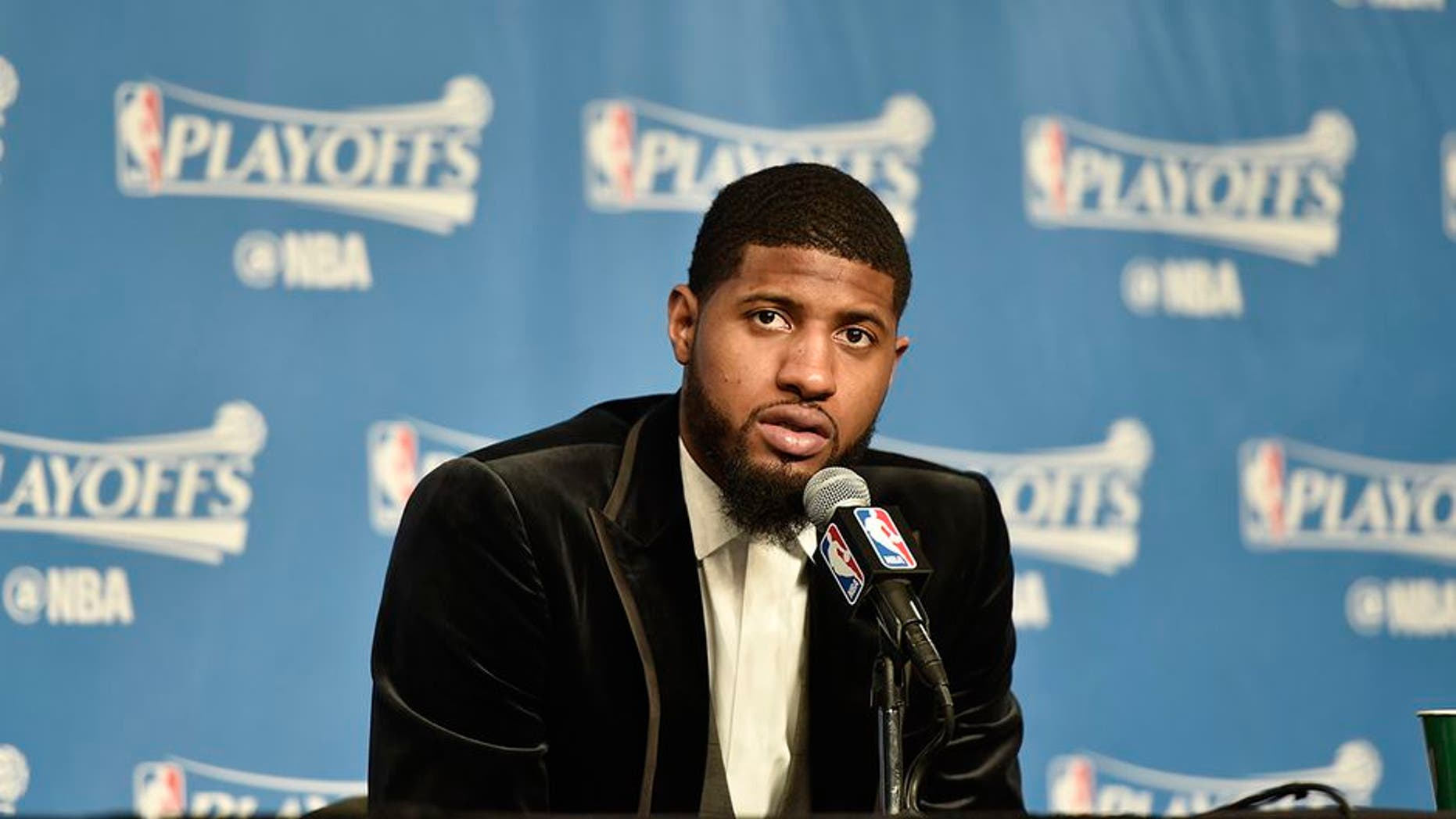 CLEVELAND, OH - APRIL 15: Paul George #13 of the Indiana Pacers speaks to the media after a game against the Cleveland Cavaliers in Round One of the Eastern Conference Playoffs during the 2017 NBA Playoffs on April 15, 2017 at Quicken Loans Arena in Cleveland, Ohio. NOTE TO USER: User expressly acknowledges and agrees that, by downloading and/or using this photograph, user is consenting to the terms and conditions of the Getty Images License Agreement. Mandatory Copyright Notice: Copyright 2017 NBAE (Photo by David Liam Kyle/NBAE via Getty Images)