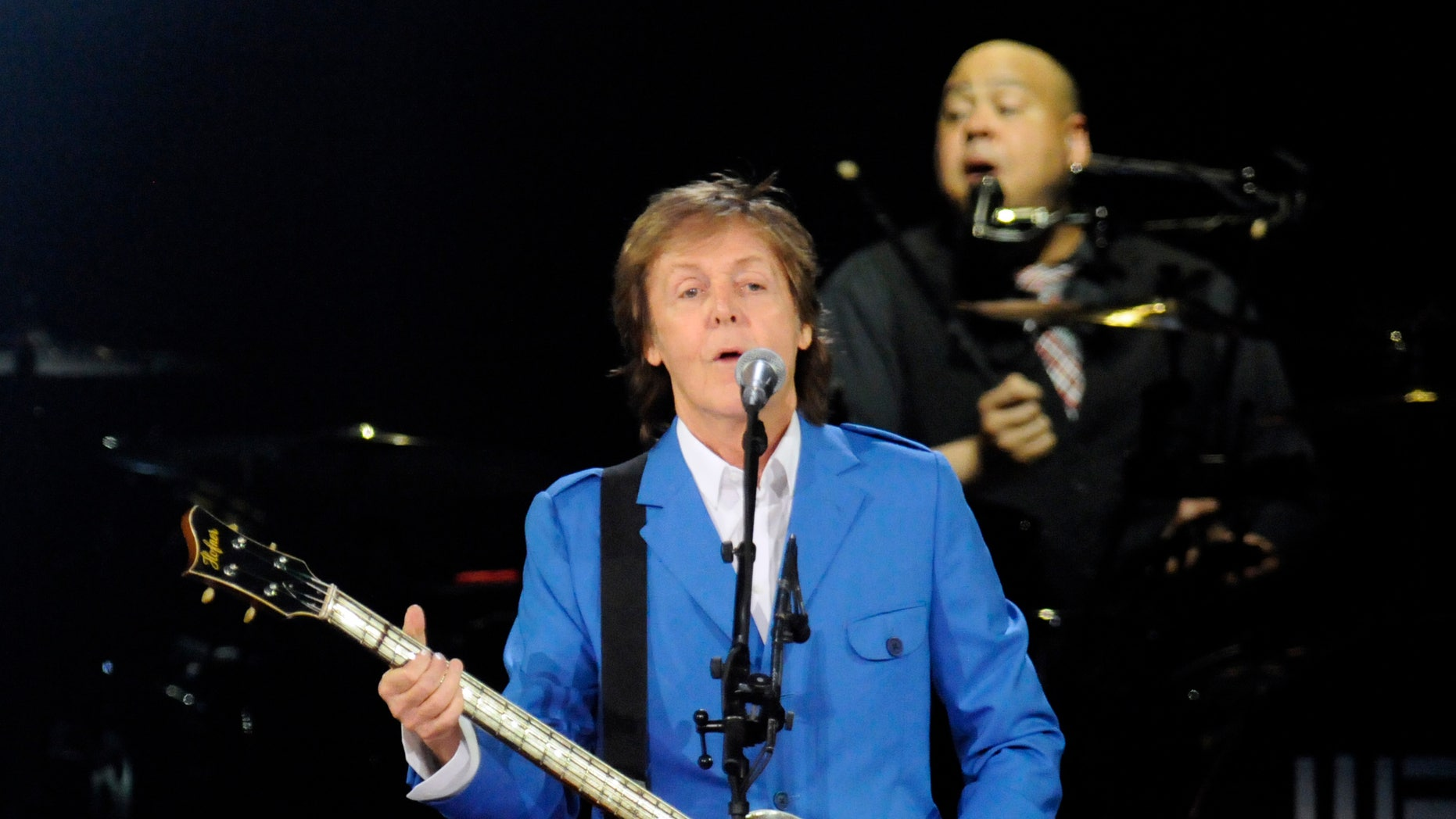 July 5, 2014. Paul McCartney performs with his band at the Times Union Center in Albany, N.Y.