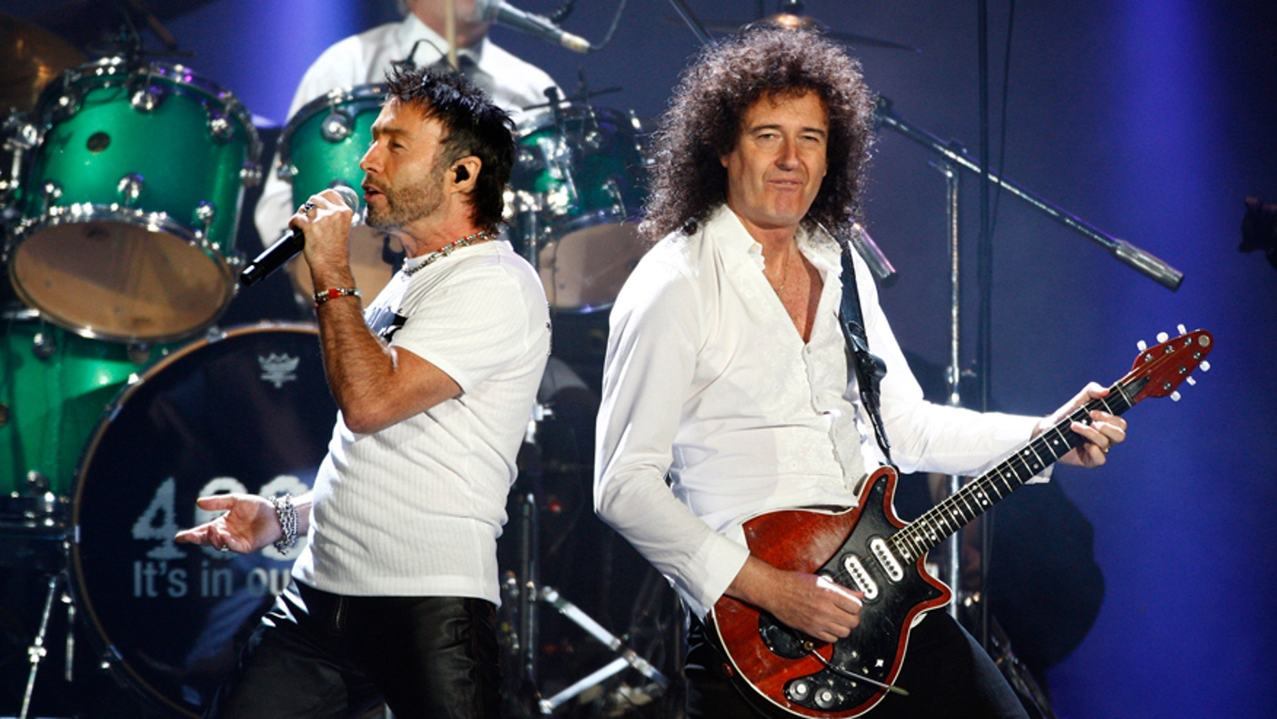 Queen's Brian May (R) and Paul Rodgers (L) perform in Hyde Park, London.