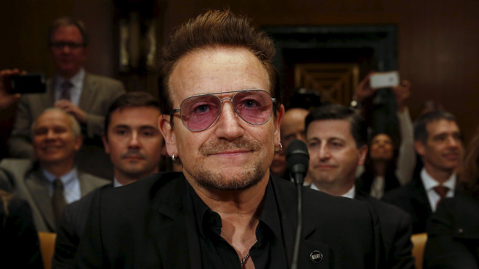 U2 lead singer Bono attends a Senate subcommittee hearing on Capitol Hill. (Reuters)