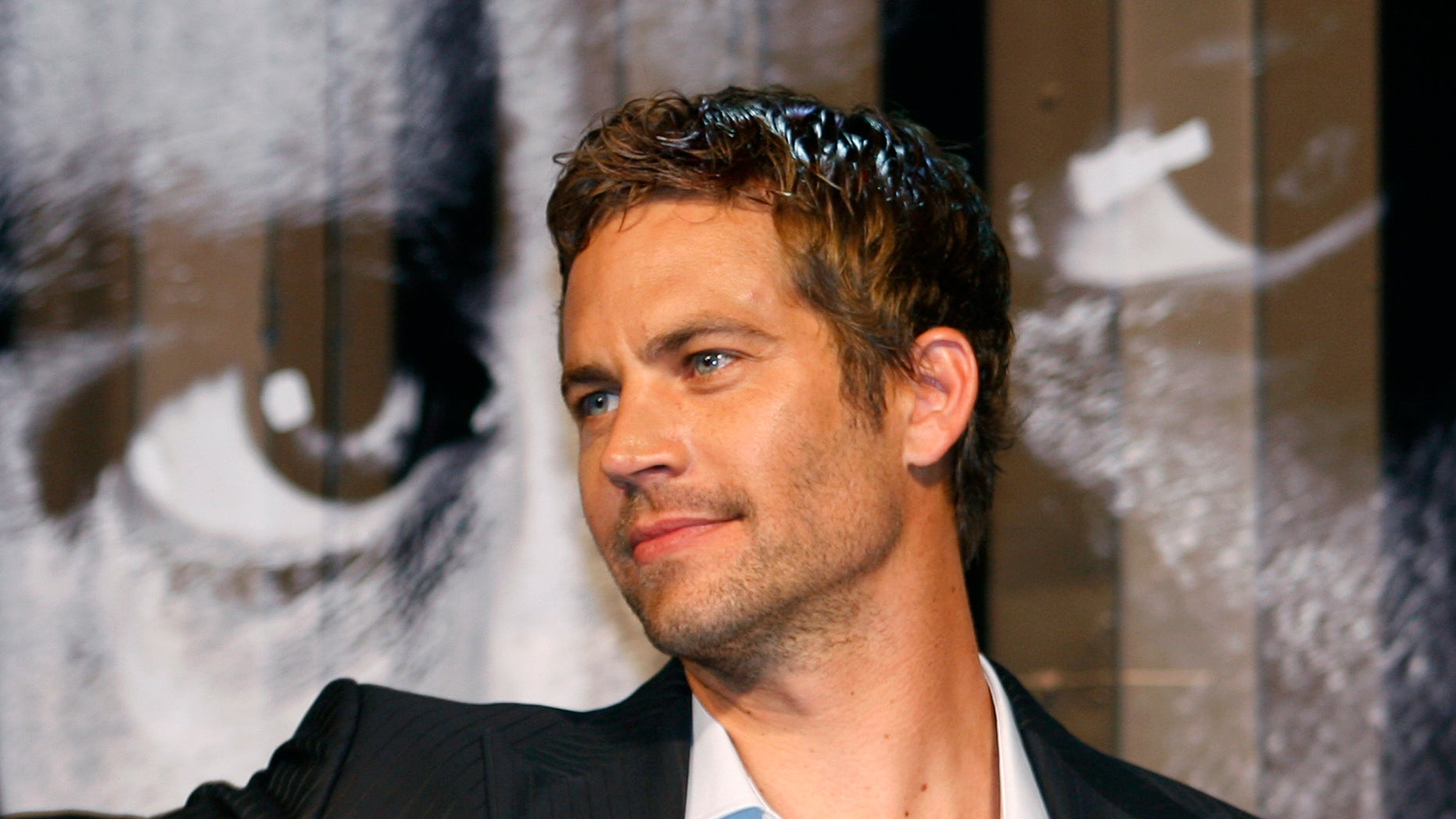 "April 15, 2009. Paul Walker smiles during the premiere of the movie  ""Fast and Furious 4"" in Taipei."