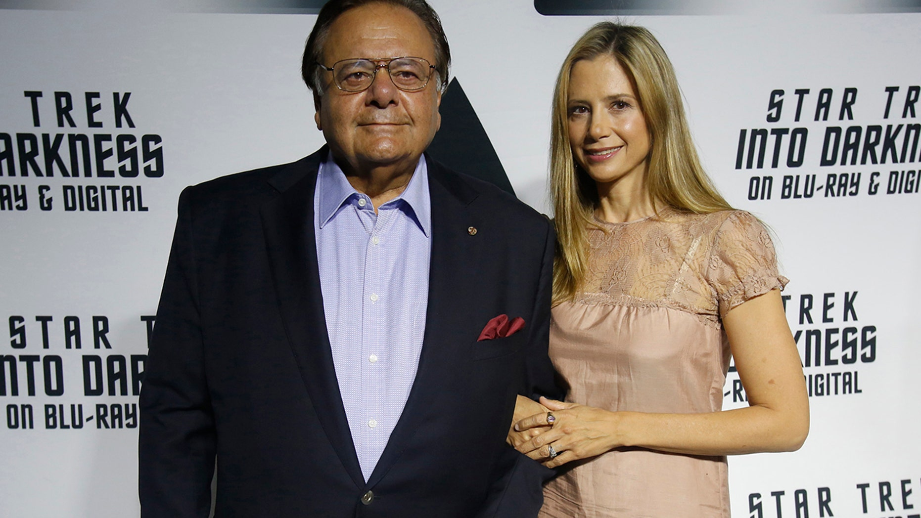 """Actor Paul Sorvino and his daughter actress Mira Sorvino pose at the party for the release of the Blu-Ray DVD of """"Star Trek Into Darkness"""" at the California Science Center in Los Angeles, California September 10, 2013."""