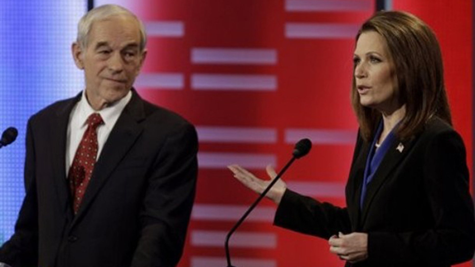 Dec. 10, 2011: Republican presidential candidates Reps. Ron Paul of Texas and Michele Bachmann of Minnesota take part in the Republican debate in Des Moines, Iowa.