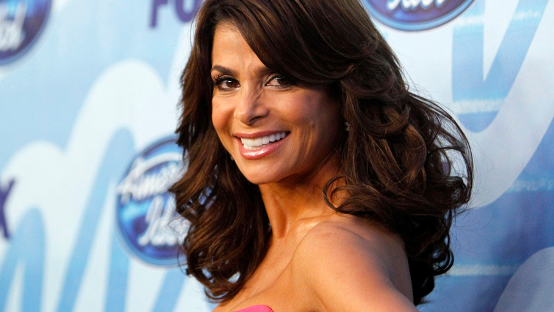 Paula Abdul poses for photographers backstage during the 9th season finale of 'American Idol' in Los Angeles May 26, 2010.