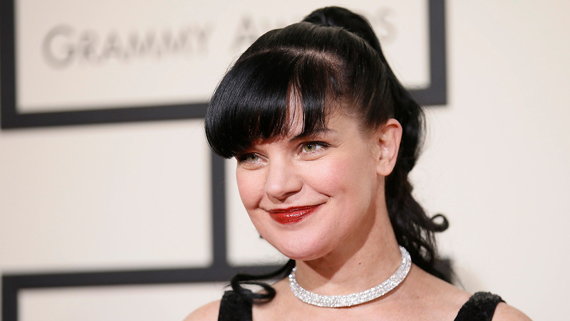 Actress Pauley Perrette arrives at the 58th Grammy Awards in Los Angeles, California February 15, 2016.  REUTERS/Danny Moloshok - TB3EC2G01YL9R