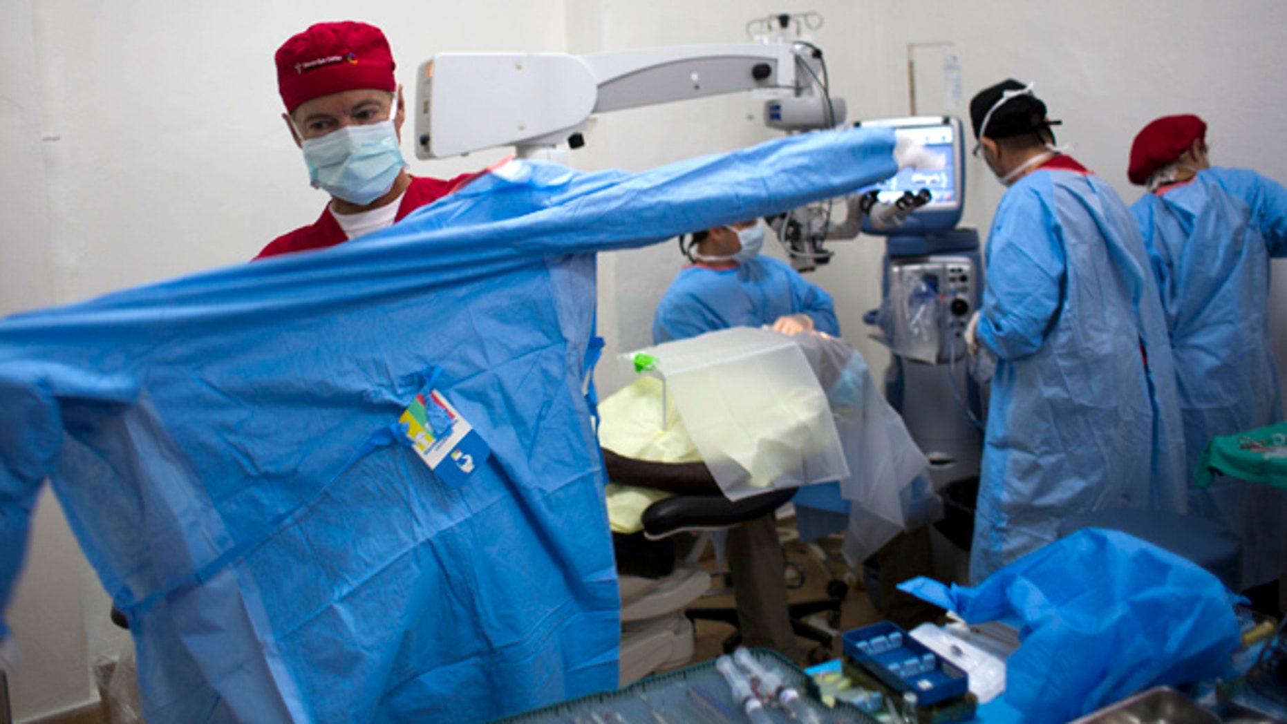 Aug. 17, 2015: Republican presidential candidate, Sen. Rand Paul, R-Ky. puts on scrubs to perform cataract surgeries in Cap-Haitien, Haiti. (AP)
