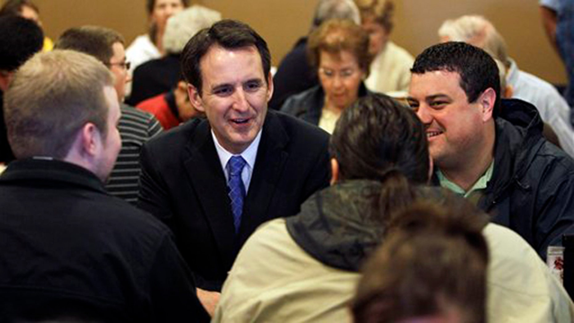 Former Minnesota Gov. Tim Pawlenty speaks with local residents during a breakfast meeting at a restaurant May 3 in Ames, Iowa.