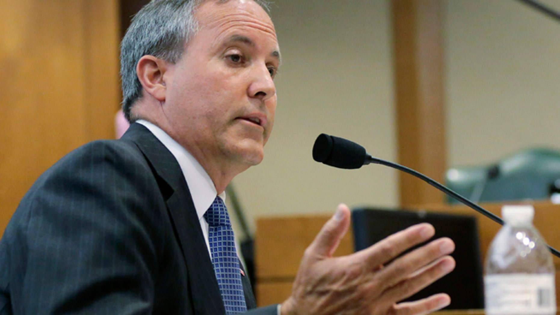 July 29, 2015: Texas Attorney General Ken Paxton speaks during a hearing in Austin, Texas.