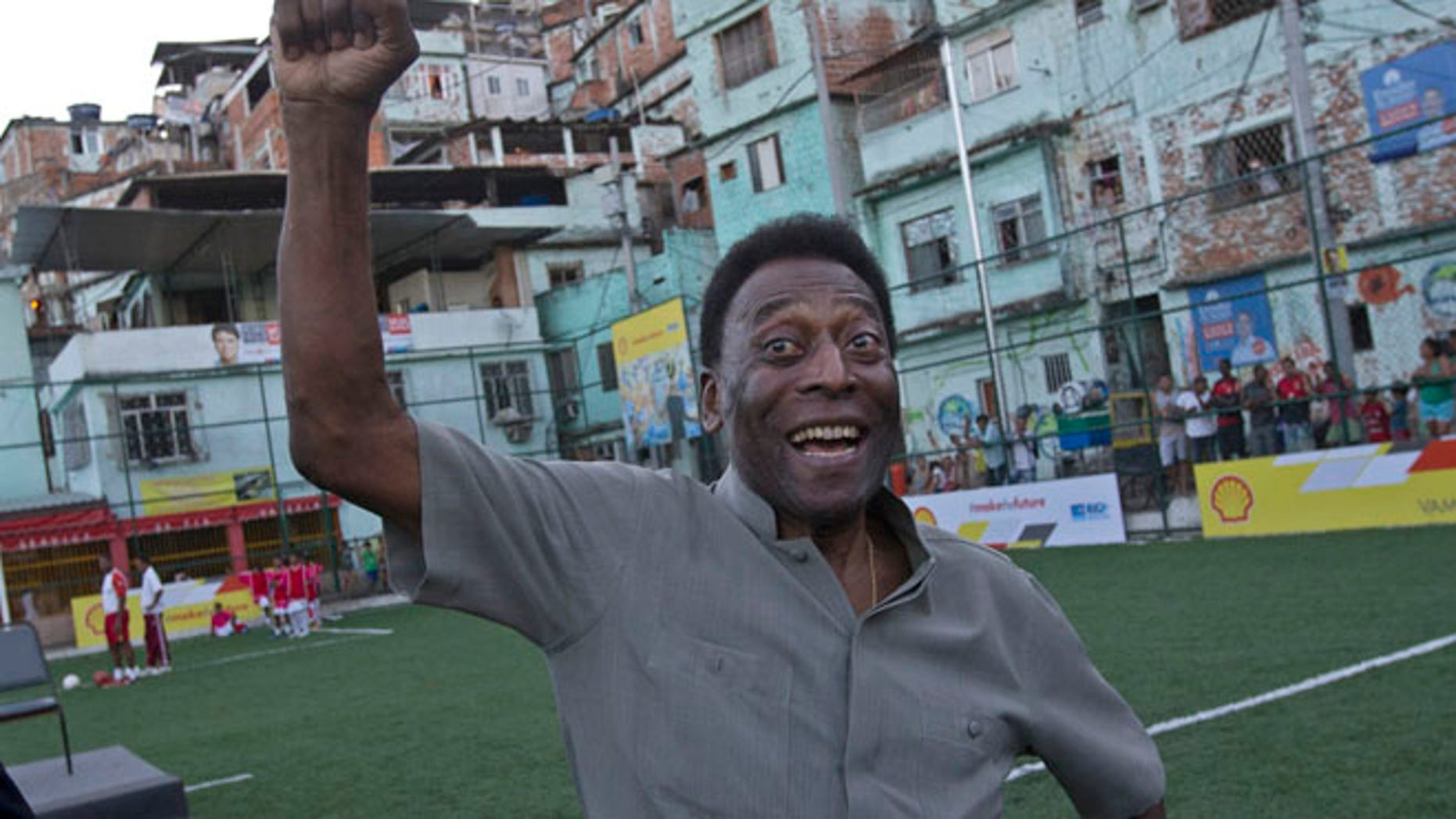 Sept. 10, 2014 Brazilian soccer great Pele pumps his fist in the air while he poses for photos during the inauguration of a soccer pitch to be powered by players' footsteps, at the Morro da Mineira favela, in Rio de Janeiro, Brazil.(AP)