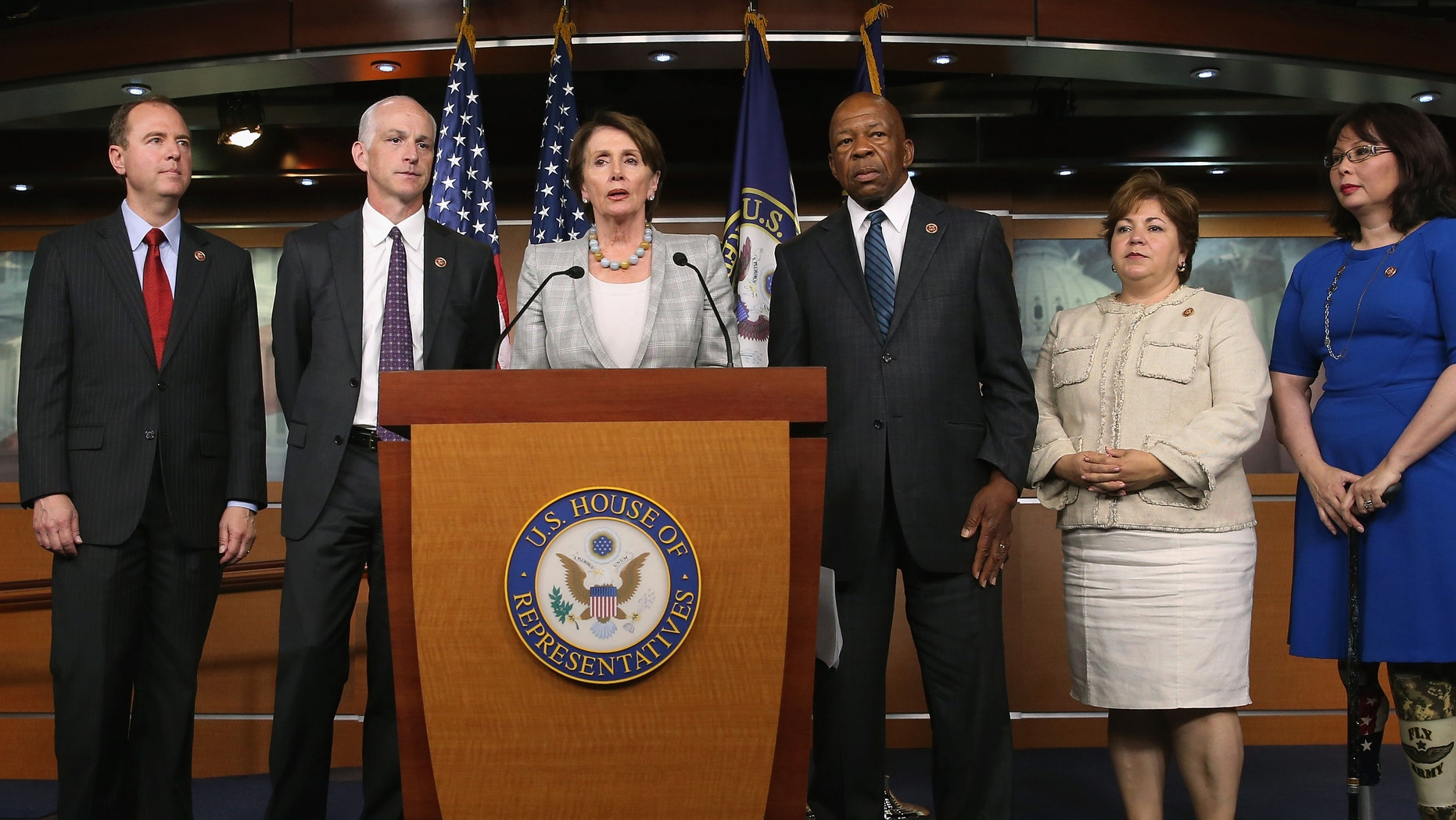 WASHINGTON, DC - MAY 21:  Minority Leader Nancy Pelosi (D-CA) (C) speaks while flanked by five fellow Democrats (L-R) Rep. Rep. Adam B. Schiff (D-CA), Rep. Adam Smith (D-WA), Rep. Elijah E. Cummings (D-MD), Rep. Linda Sanchez, (D-CA) and Rep. Tammy Duckworth (D-IL) during a news conference on Capitol Hill, May 21, 2014 in Washington, DC. Leader Pelosi named the five Democrats to serve on the special committee looking into the 2012 attack in Benghazi, Libya.  (Photo by Mark Wilson/Getty Images,)