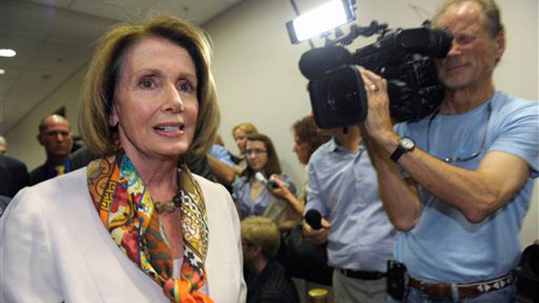 House Minority Leader Nancy Pelosi walks past reporters as she heads to a Democratic caucus meeting on Capitol Hill in Washington Aug. 1.