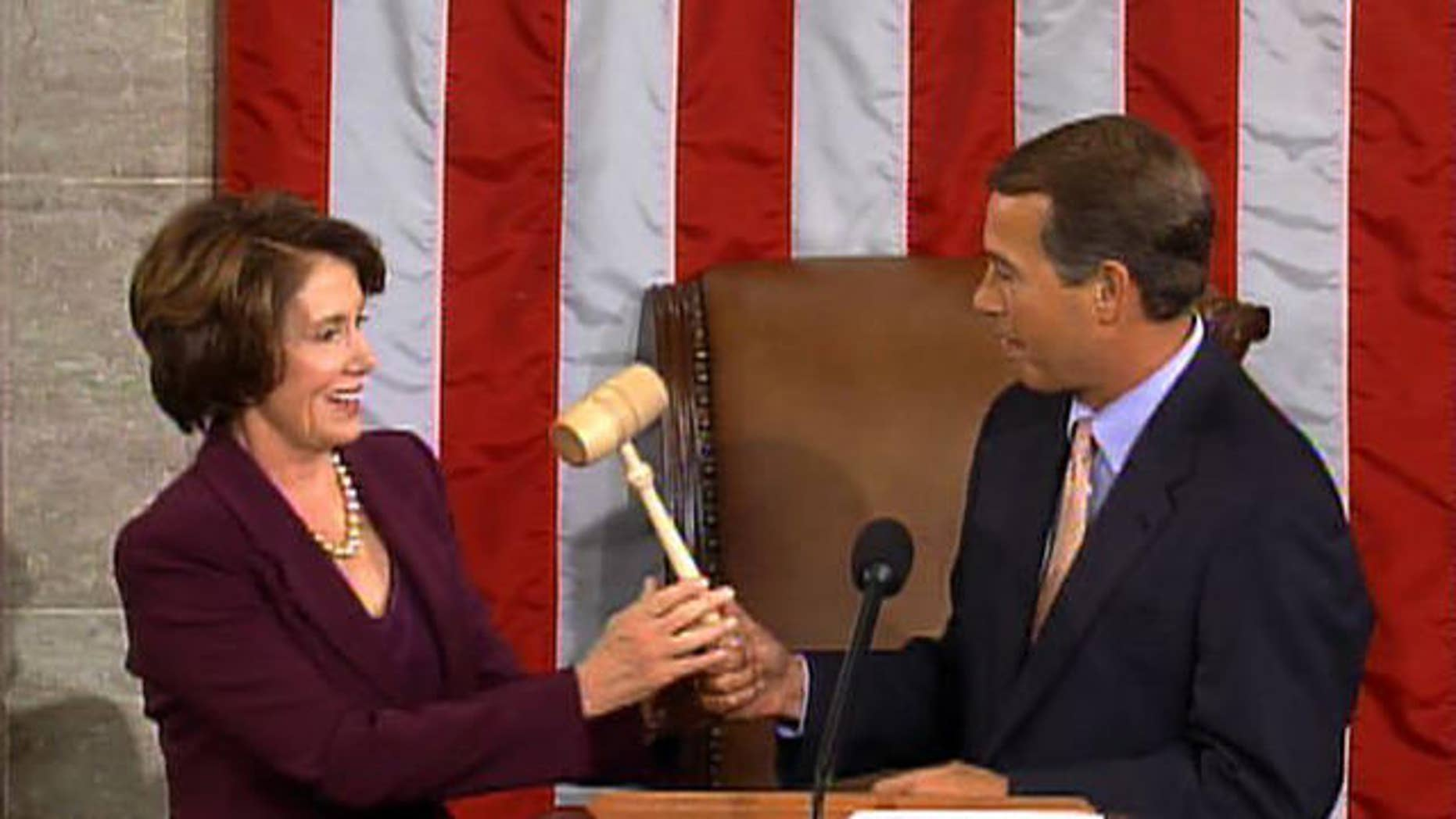 FILE: In this Jan. 4, 2007, photo, Minority Leader John Boehner hands the gavel to newly sworn-in Speaker Nancy Pelosi. A reversal of the two leaders' roles was happening Wednesday.