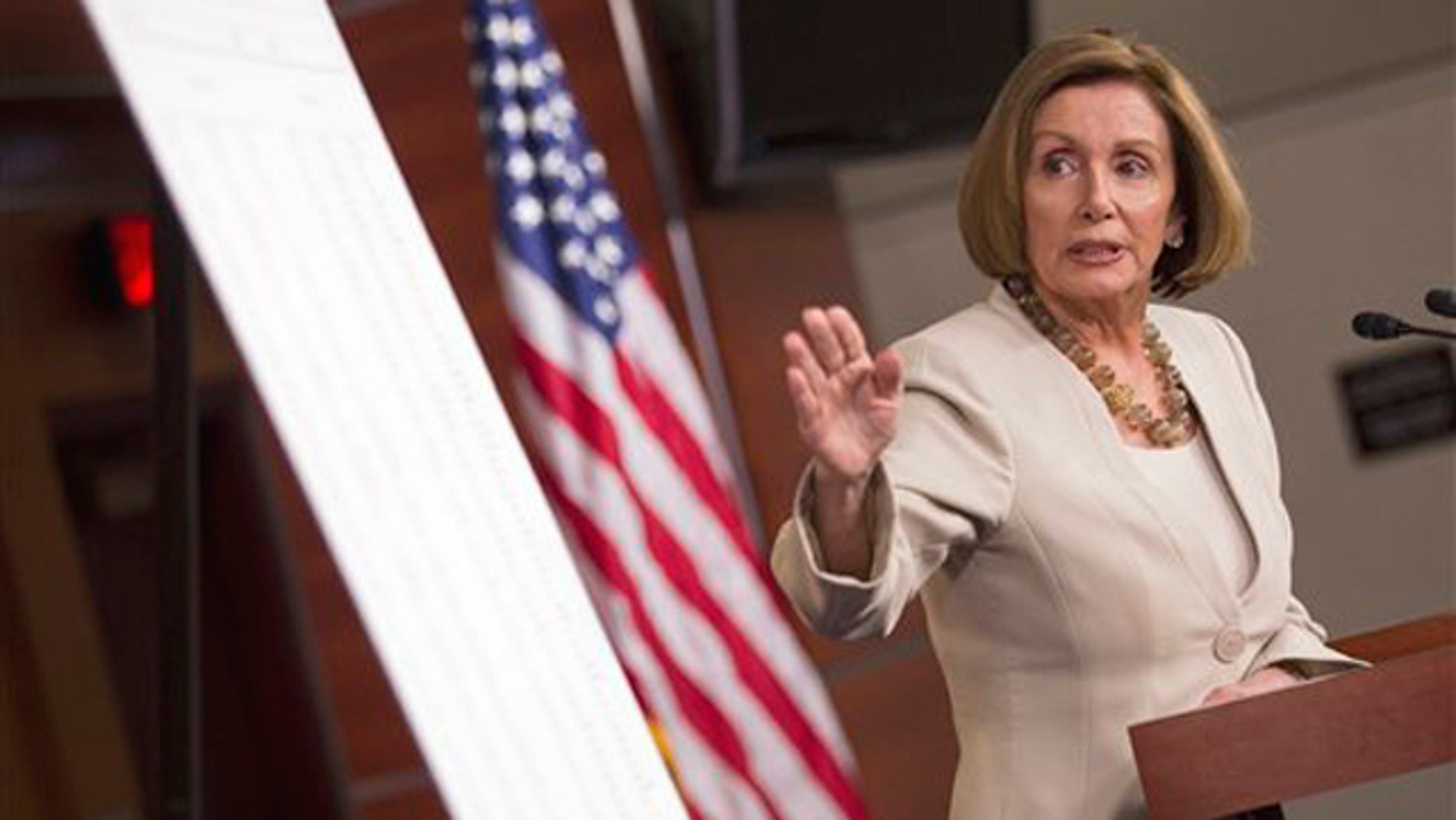 House Minority Leader Nancy Pelosi points to a chart during a news conference on Capitol Hill in Washington May 12.
