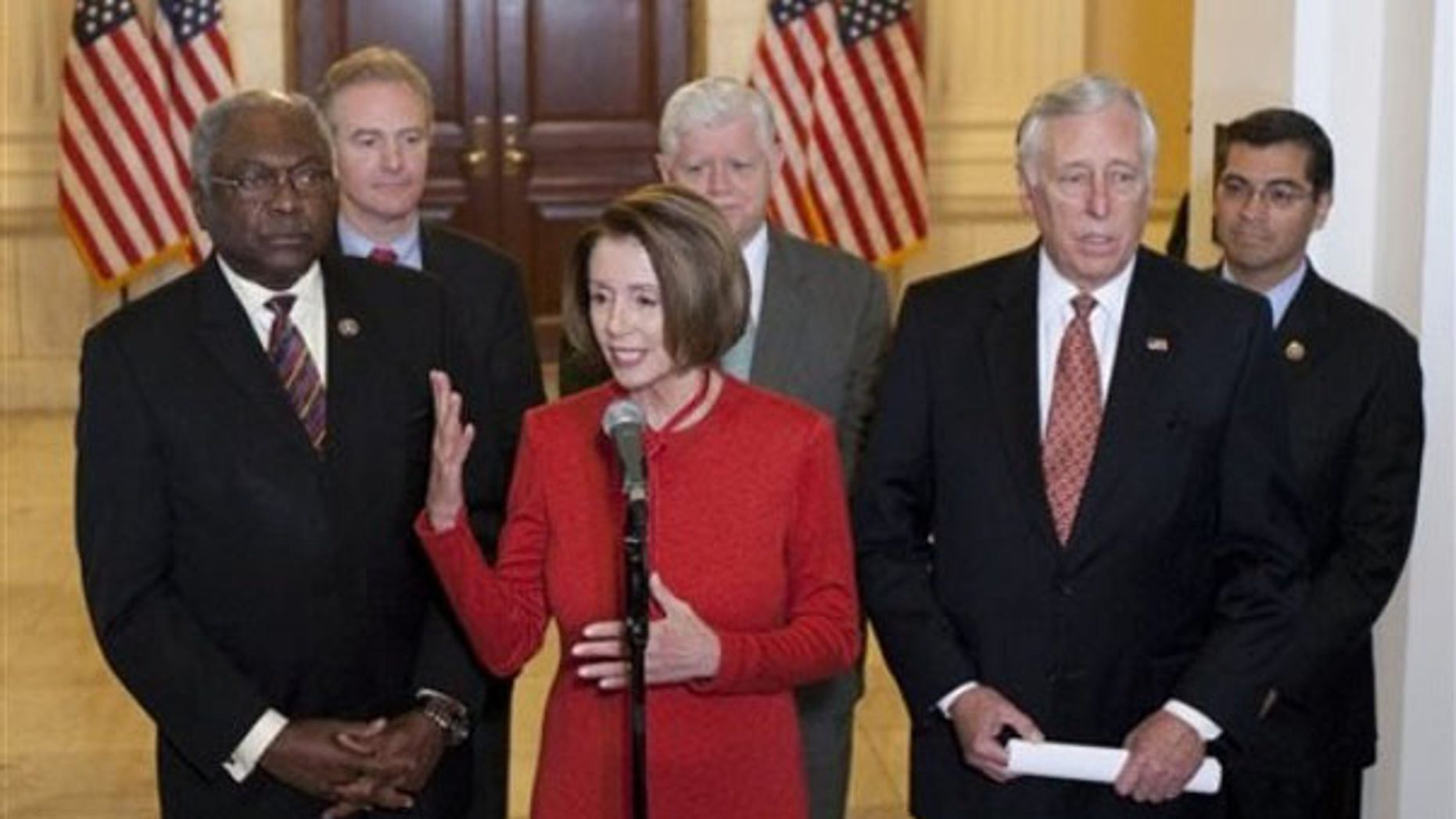 Democratic leaders, Speaker Nancy Pelosi, Majority Whip James Clyburn and Rep. Steny Hoyer, seen here in November, are working to limit losses of Democratic seats in the 2010 election, but recognize the historic challenges. In the back are Rep. Chris Van Hollen, Rep. John Larson and Rep. Xavier Becerra (AP Photo).