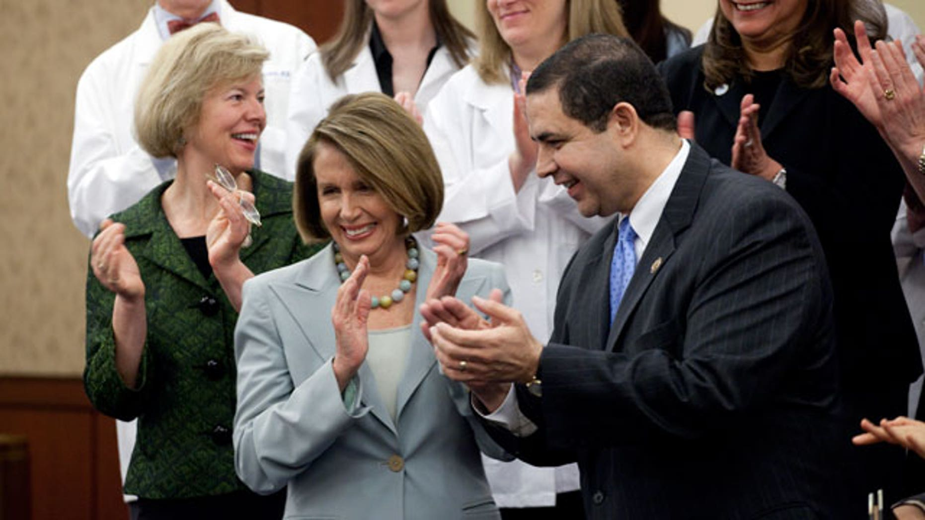 Rep. Tammy Baldwin, D-Wisc., Democratic Minority Leader, Nancy Pelosi, D-Calif., and Rep. Henry Cuellar, D-Tex., at a ceremony marking the one year anniversary of the passage of the Health Care Act on Capitol Hill in Washington on Thursday, March 17, 2011. (AP)