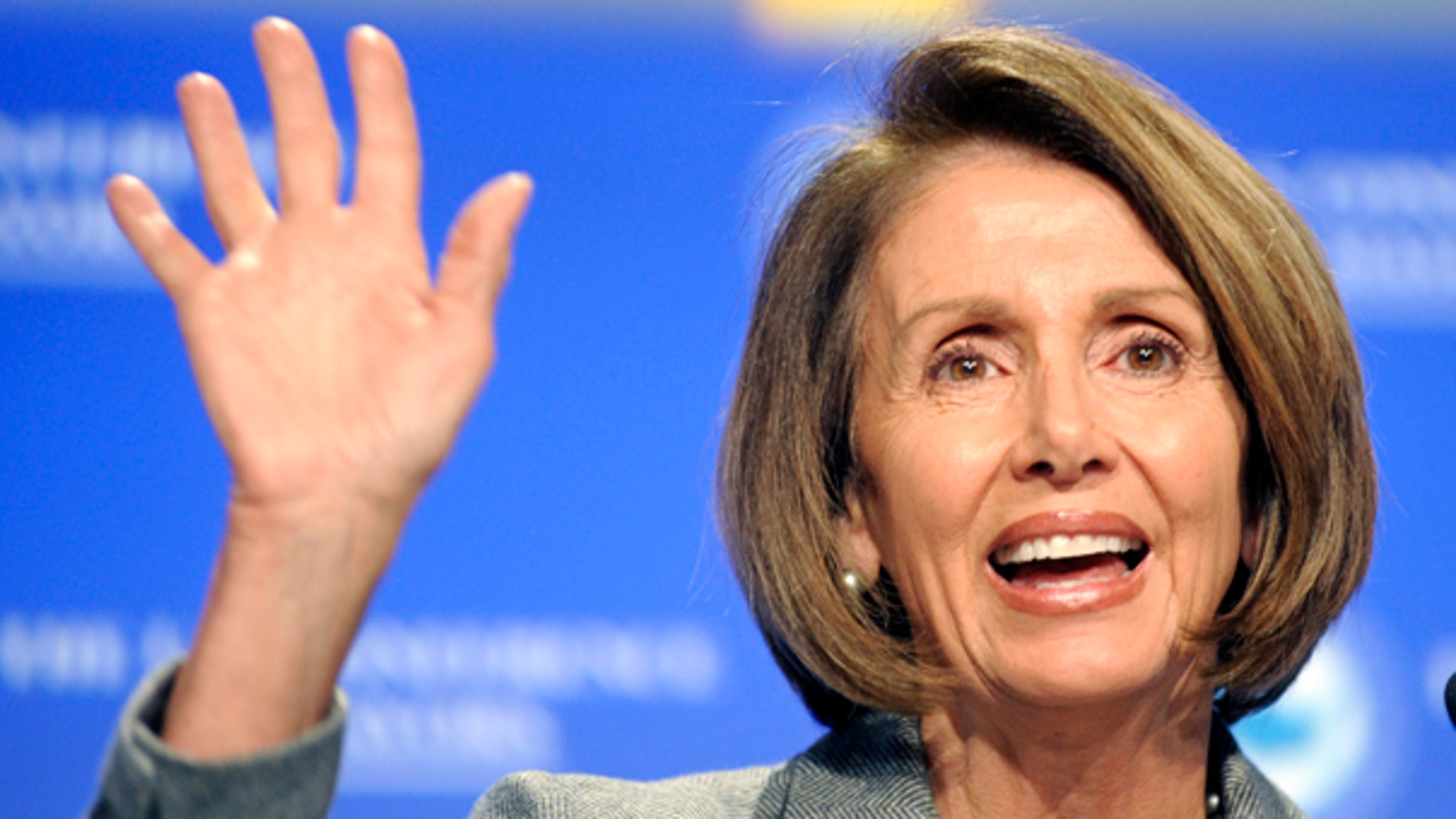 Wednesday: Speaker Nancy Pelosi waves to the crowd at the U.S. Conference on Mayors Wednesday. On Thursday, she waved off House passage of the Senate's health insurance reform bill. (AP)