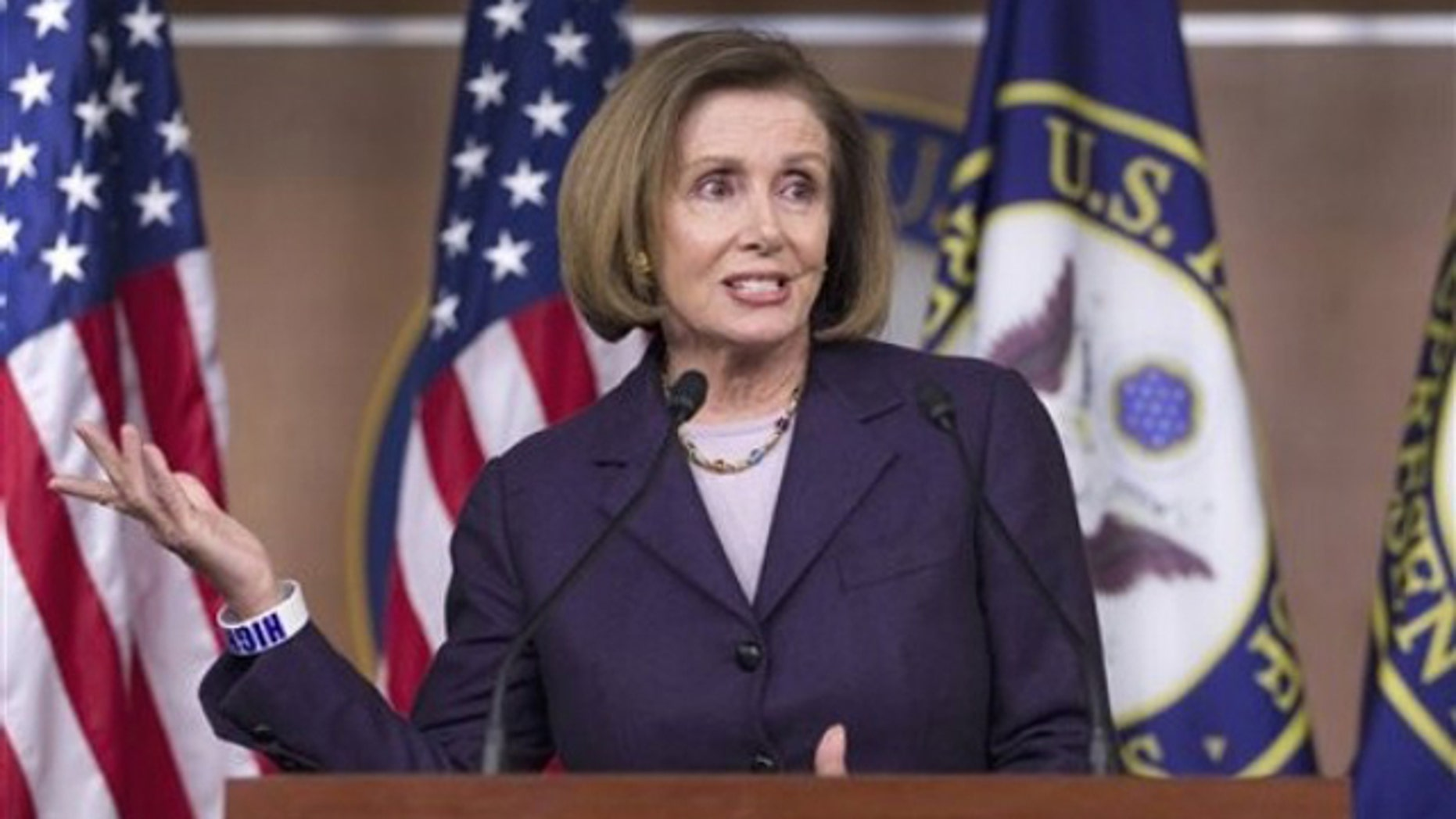 House Minority Leader Nancy Pelosi gestures during a news conference on Capitol Hill April 14.