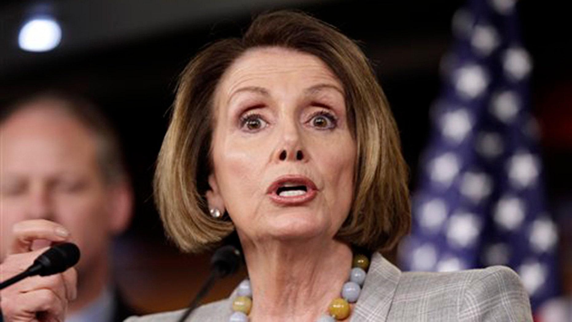 House Minority Leader Nancy Pelosi speaks to reporters June 16 on Capitol Hill in Washington.