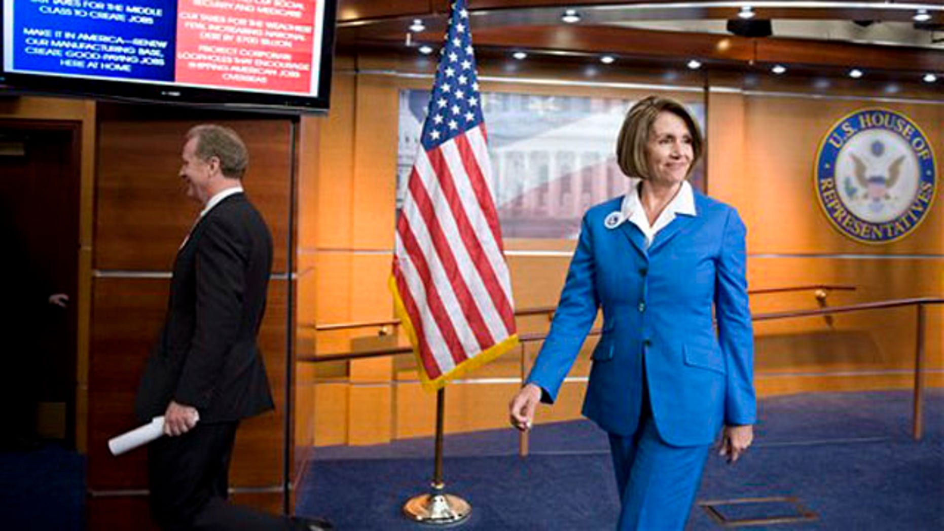 House Speaker Nancy Pelosi, right, and Rep. Chris Van Hollen, left, leave a news conference on Capitol Hill Sept. 30. (AP Photo)