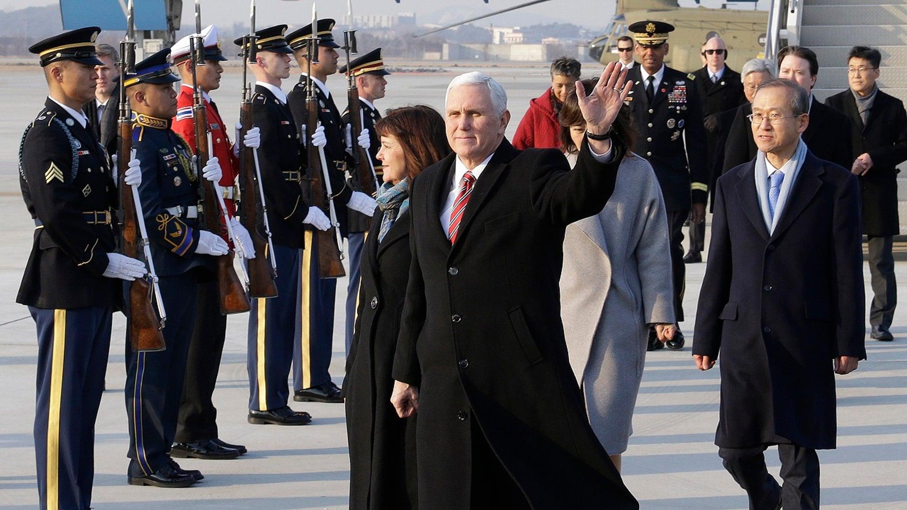 Vice President Mike Pence waves upon his arrival at Osan Air Base in Pyeongtaek, South Korea, Feb. 8, 2018.