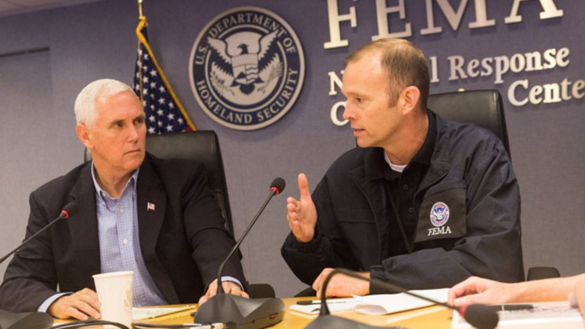 Vice President Mike Pence meets with FEMA Administrator Brock Long at the agency's headquarters Saturday.
