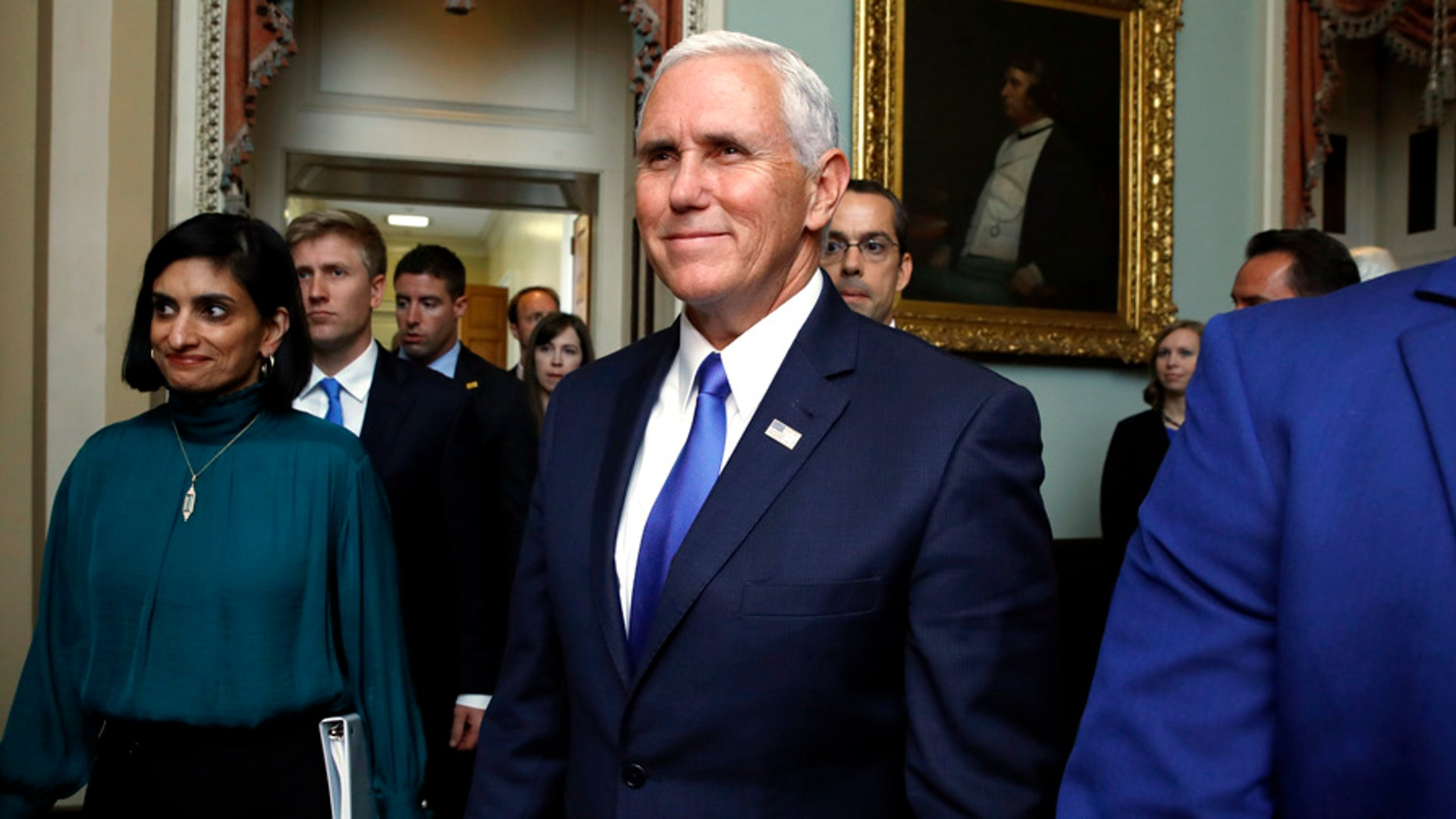 Vice President Mike Pence leaves a meeting with Republican senators, Tuesday, Sept. 19, 2017, on Capitol Hill in Washington. (AP Photo/Jacquelyn Martin)