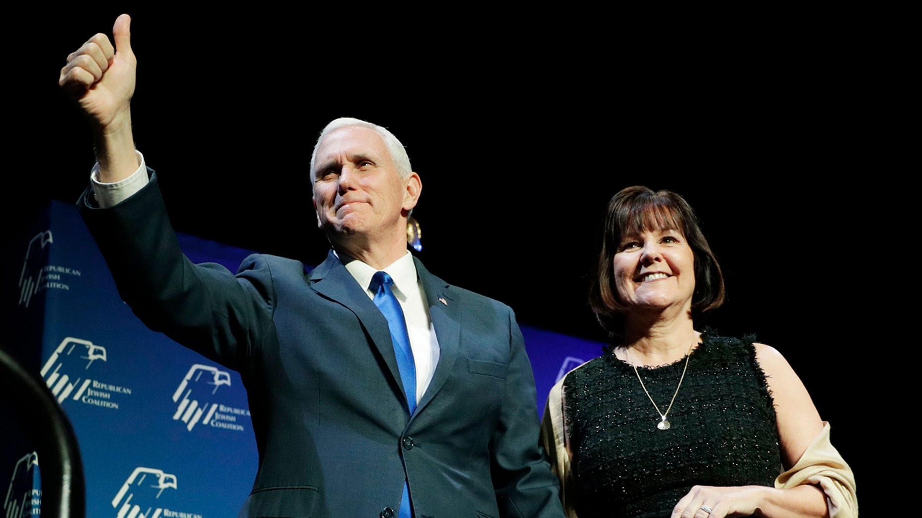 Vice President Mike Pence, left, takes the stage with his wife Karen Pence at the Republican Jewish Coalition annual leadership meeting, Friday, Feb. 24, 2017, in Las Vegas. (AP Photo/John Locher)