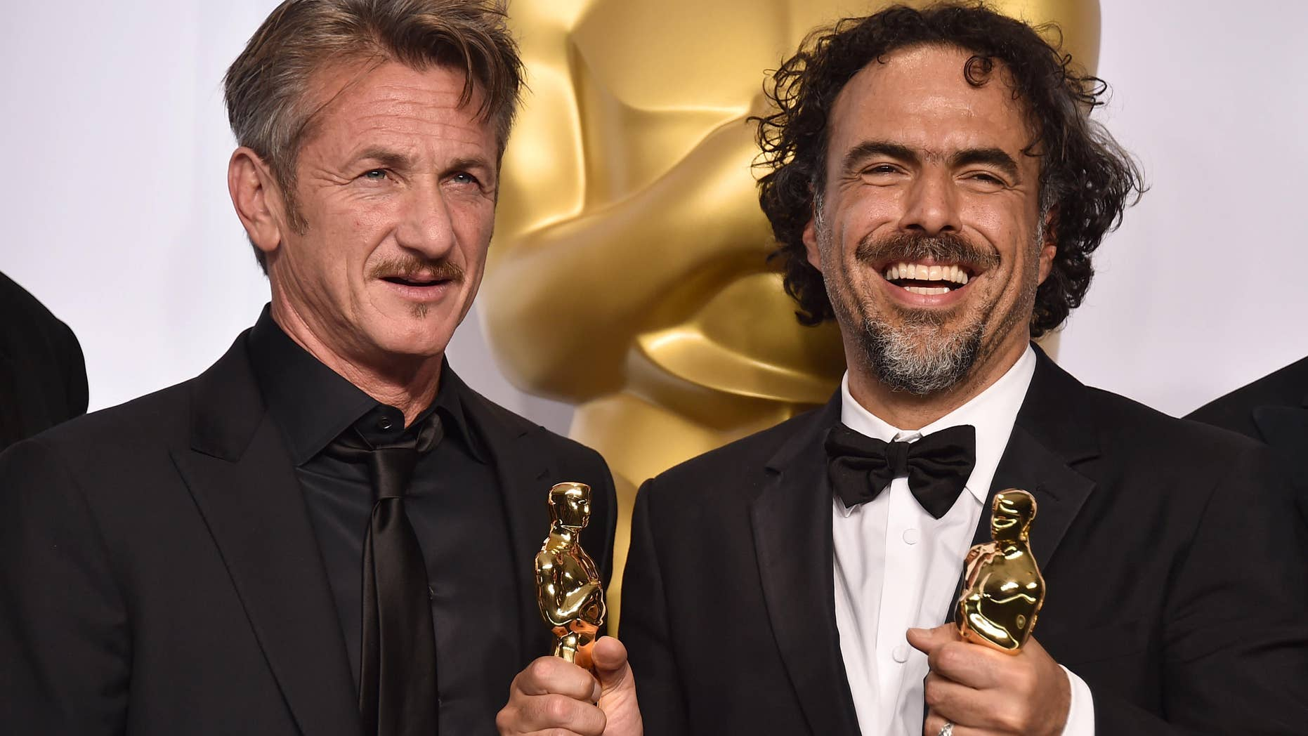 """Feb. 22, 2015: Presenter Sean Penn, left, and filmmaker Alejandro Iñárritu pose in the press room after winning multiple awards including best original screenplay, best director and best picture for """"Birdman: Or (The Unexpected Virtue of Ignorance),"""" at the Oscars in Los Angeles."""