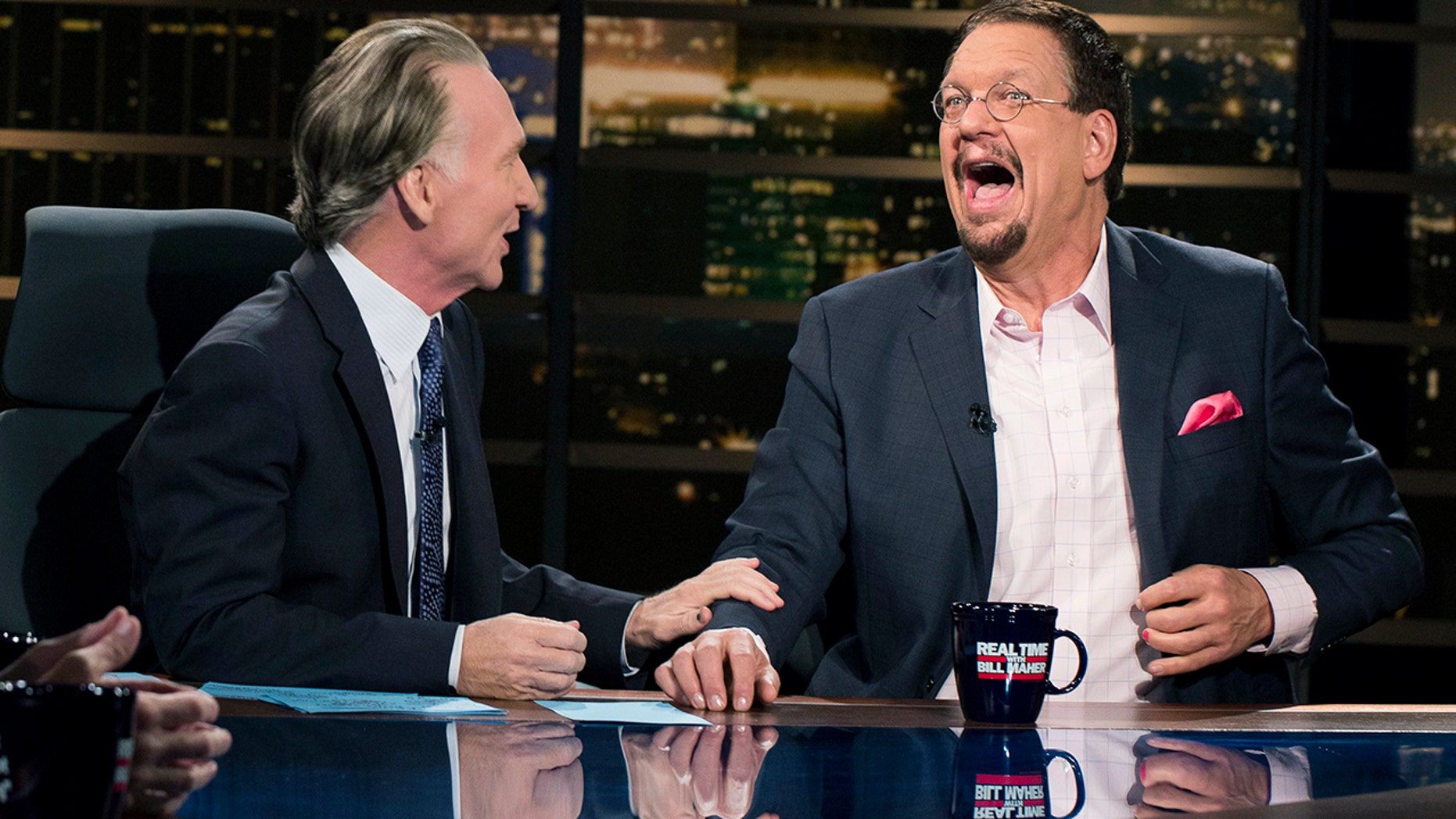 "In this Friday, Aug. 18 , 2017 photo provided by HBO, Penn Jillette, right, appears on Bill Maher's ""Real Time,"" in Los Angeles. Jillette is apologizing profusely for his wisecracks insulting Newfoundland. The talkative half of the Penn & Teller magic and comedy act called Newfoundland, quote, ""a euphemism for stupid"" during Friday's ""Overtime with Bill Maher,"" an online follow-up to Maher's weekly ""Real Time"" talk show on HBO."
